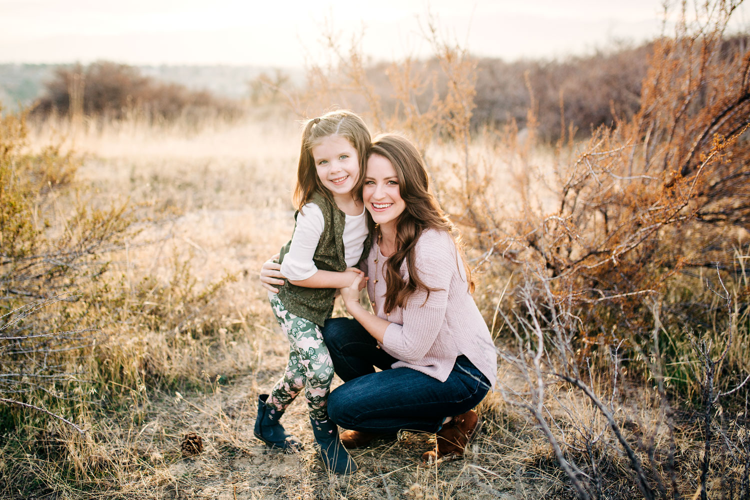 A mother and daughter hug together during a family photo shoot with Amy Wright Photography, who is based out of Roseville, California.