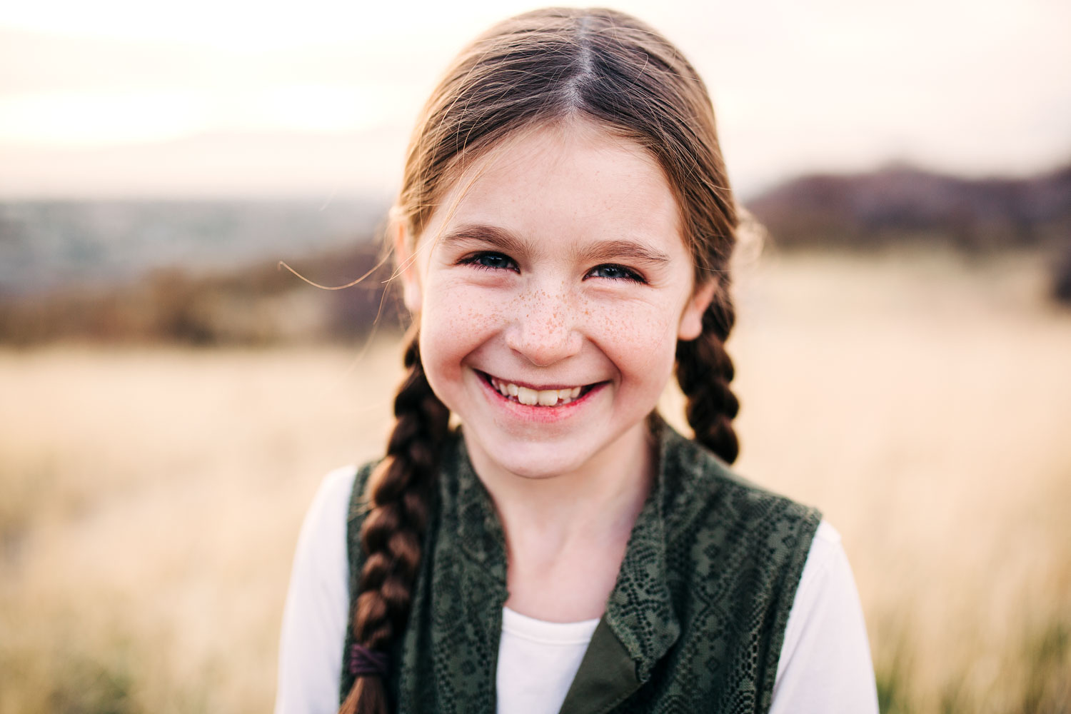A girl smiles for her portrait during family pictures with Amy Wright, a photographer based out of Sacramento, California.