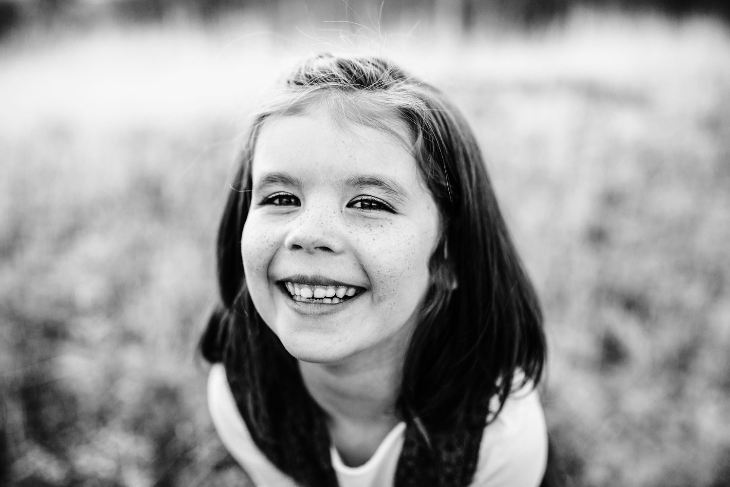 A classic portrait of a girl smiling is taken by Amy Wright, a family photographer based out of Roseville, California.