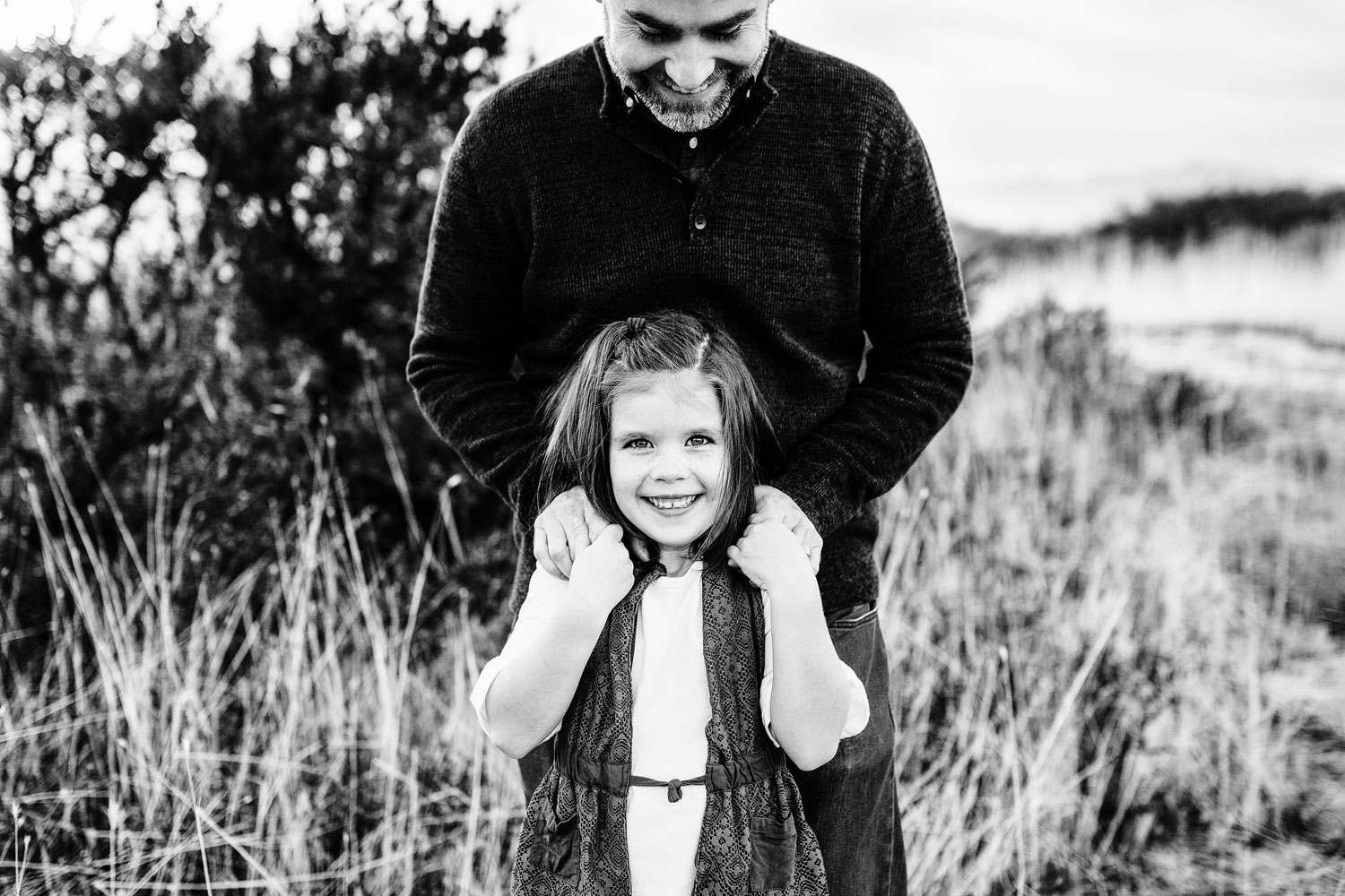 A black-and-white photo shows a timeless capture of a father and daughter, taken by Amy Wright Photography, based out of Roseville, California.