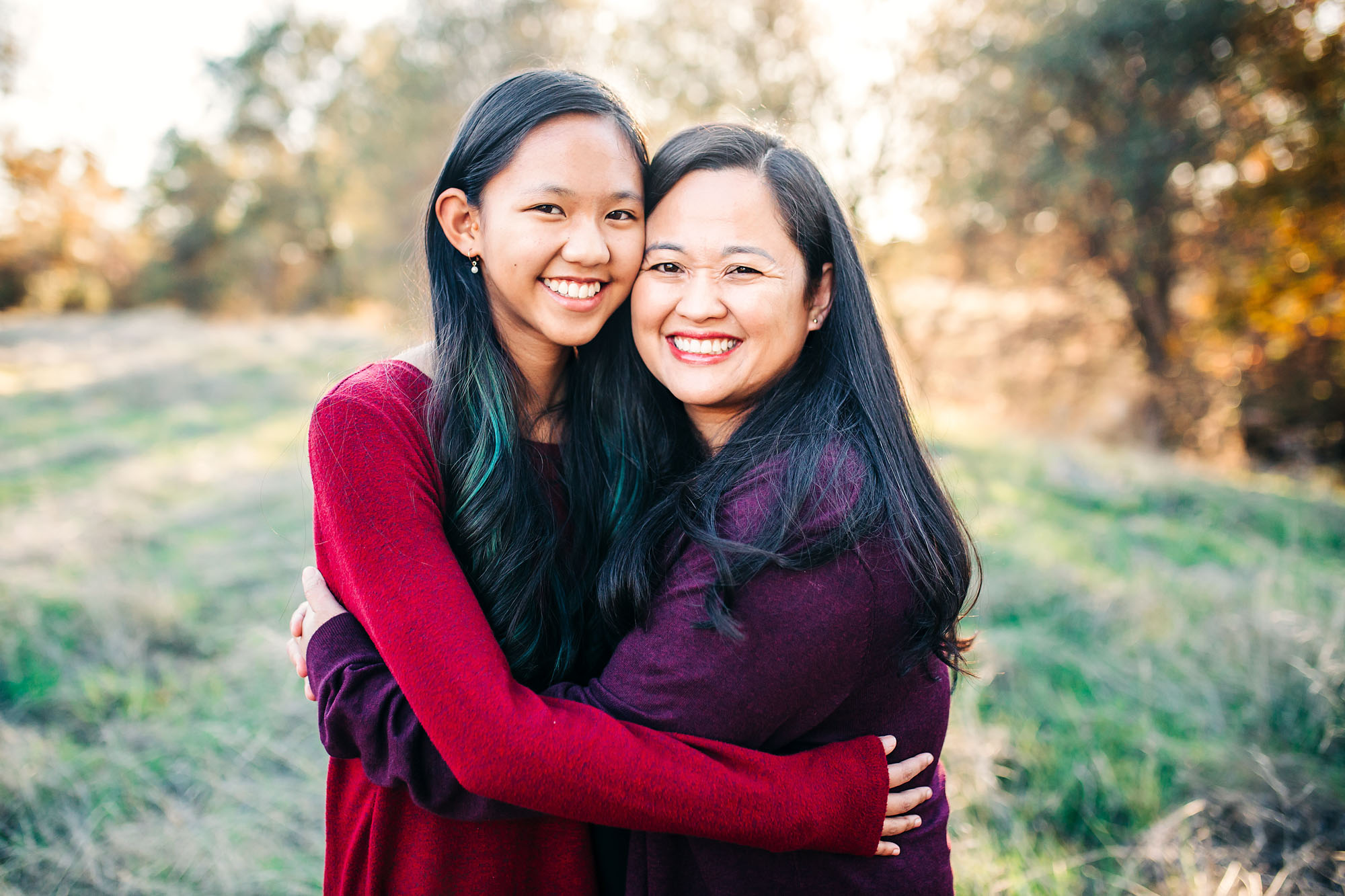 A mother and daughter embrace happily during a family photo shoot with Amy Wright Photography in Sacramento, California.
