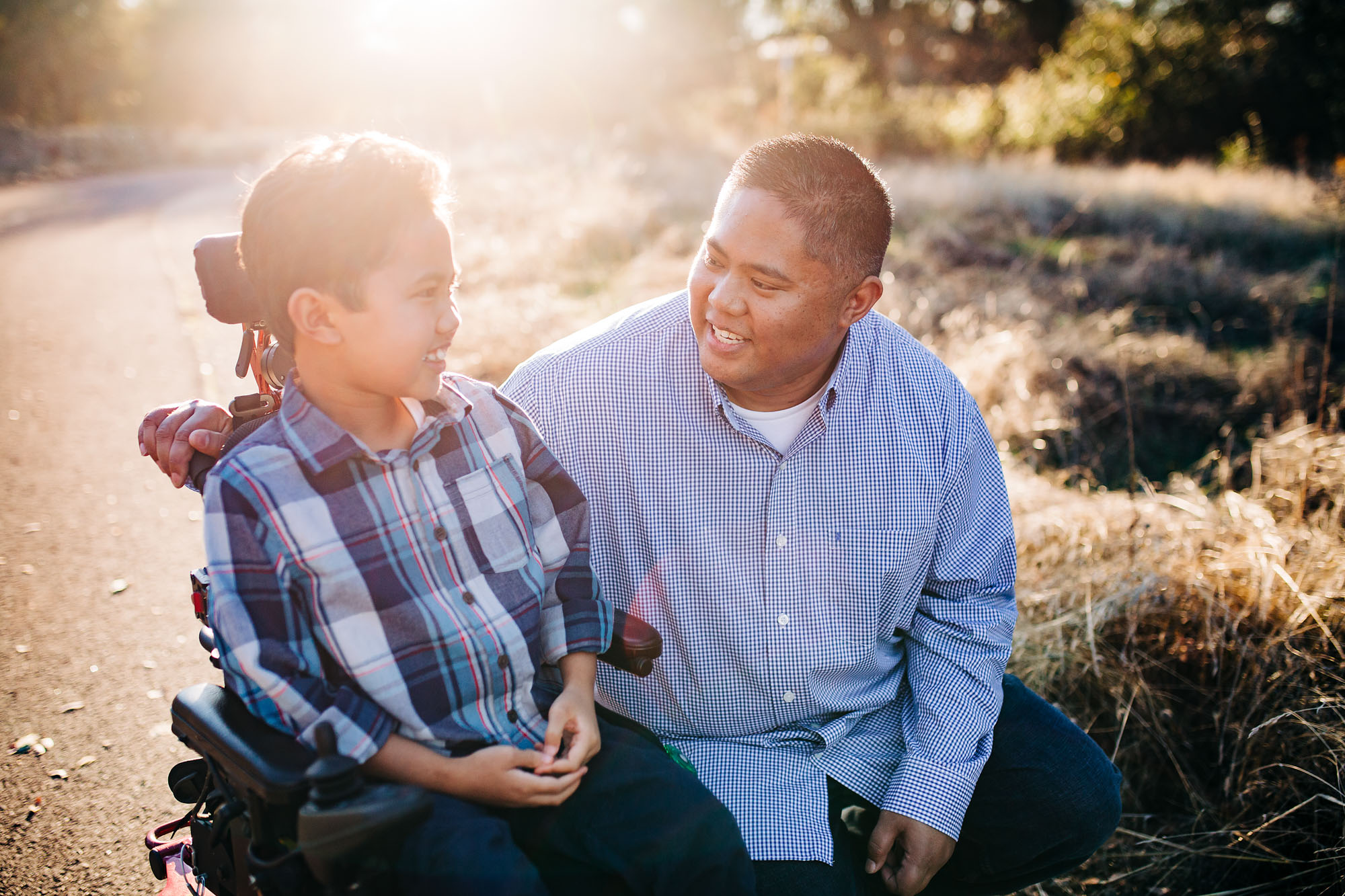 A father and son lovingly look at each other during a family photo session with Amy Wright Photography in Roseville, California.