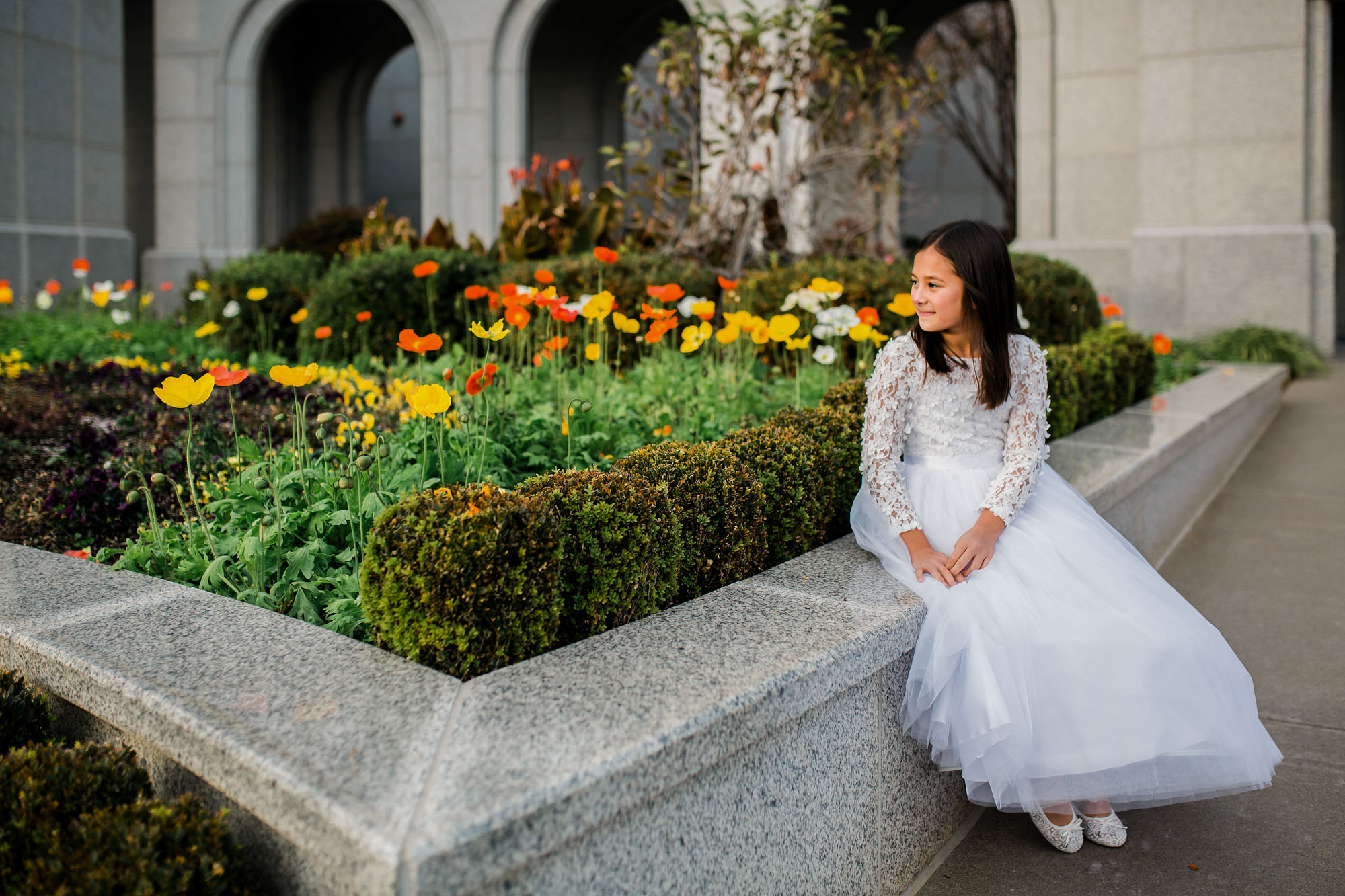 An 8-year-old girl has baptism pictures taken at a temple of The Church of Jesus Christ of Latter-day Saints in Folsom, California.