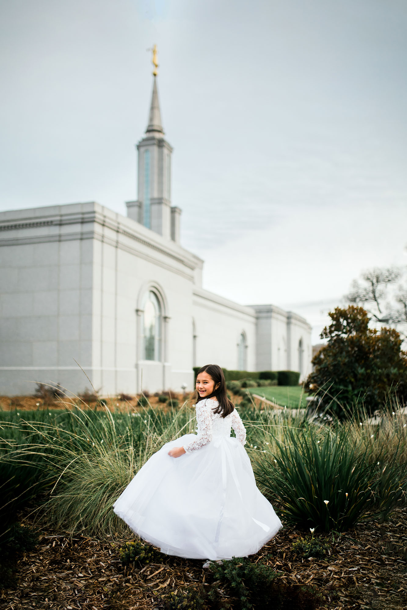 An 8-year-old girl gets pictures taken at a temple in Folsom, California before she gets baptized. Pictures taken by Amy Wright, a photographer based out of Roseville.