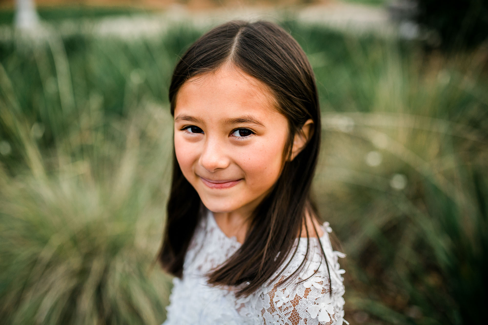 An 8-year-old girl's portrait is captured during a lifestyle photo session with Amy Wright Photography, who is based out of Roseville, California.