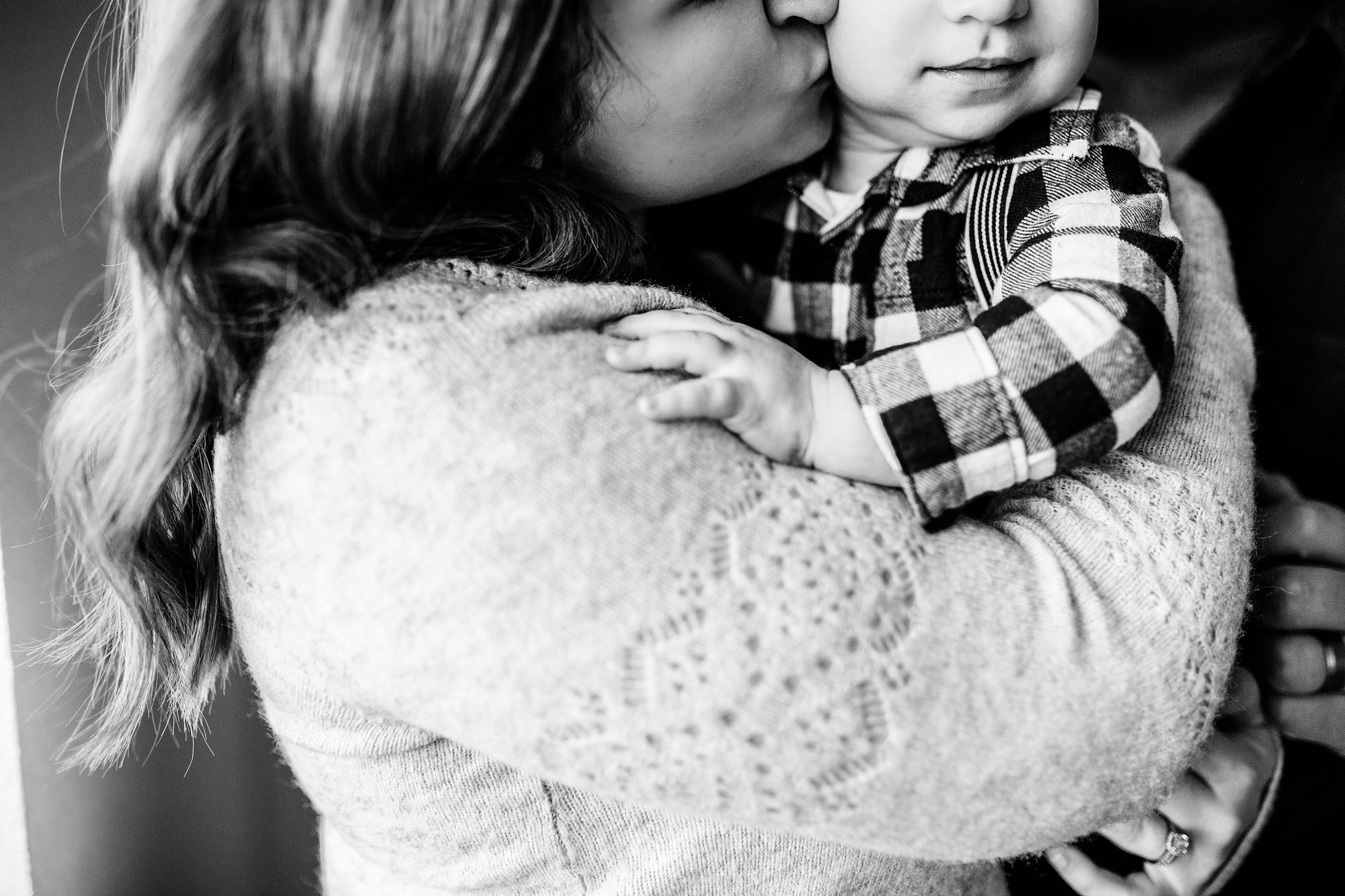 Details are captured of a mother and son's beautiful bond during an in-home family photo session with Amy Wright, a photographer based out of Sacramento, California.