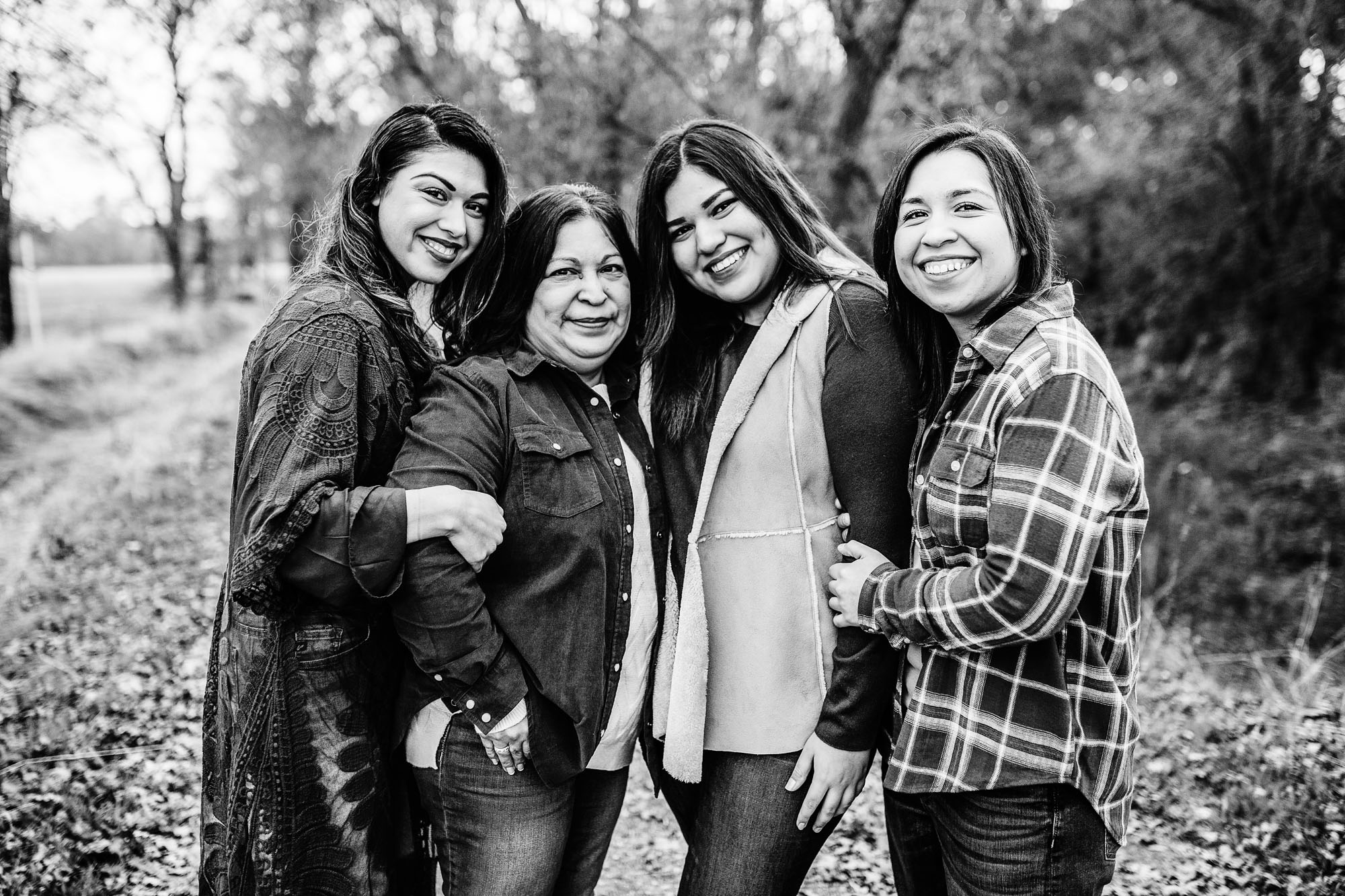 A mother and her daughters smile for family pictures with lifestyle photographer Amy Wright in Roseville, California.