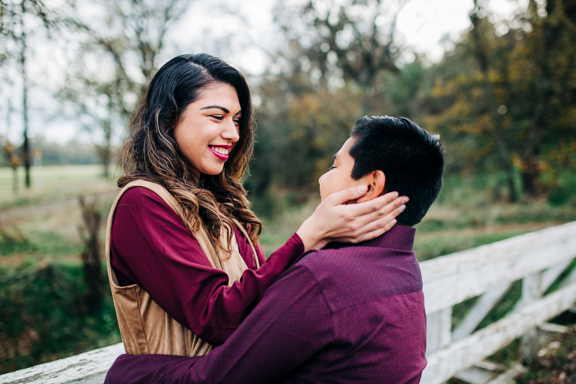 A mother looks lovingly at her son during lifestyle family pictures taken by Amy Wright Photo in Roseville, California.