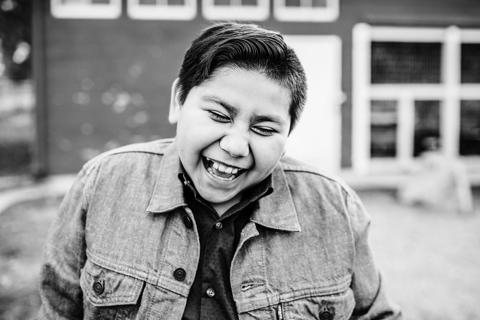 A boy laughs as his portrait is taken in Roseville, California by Amy Wright Photo.