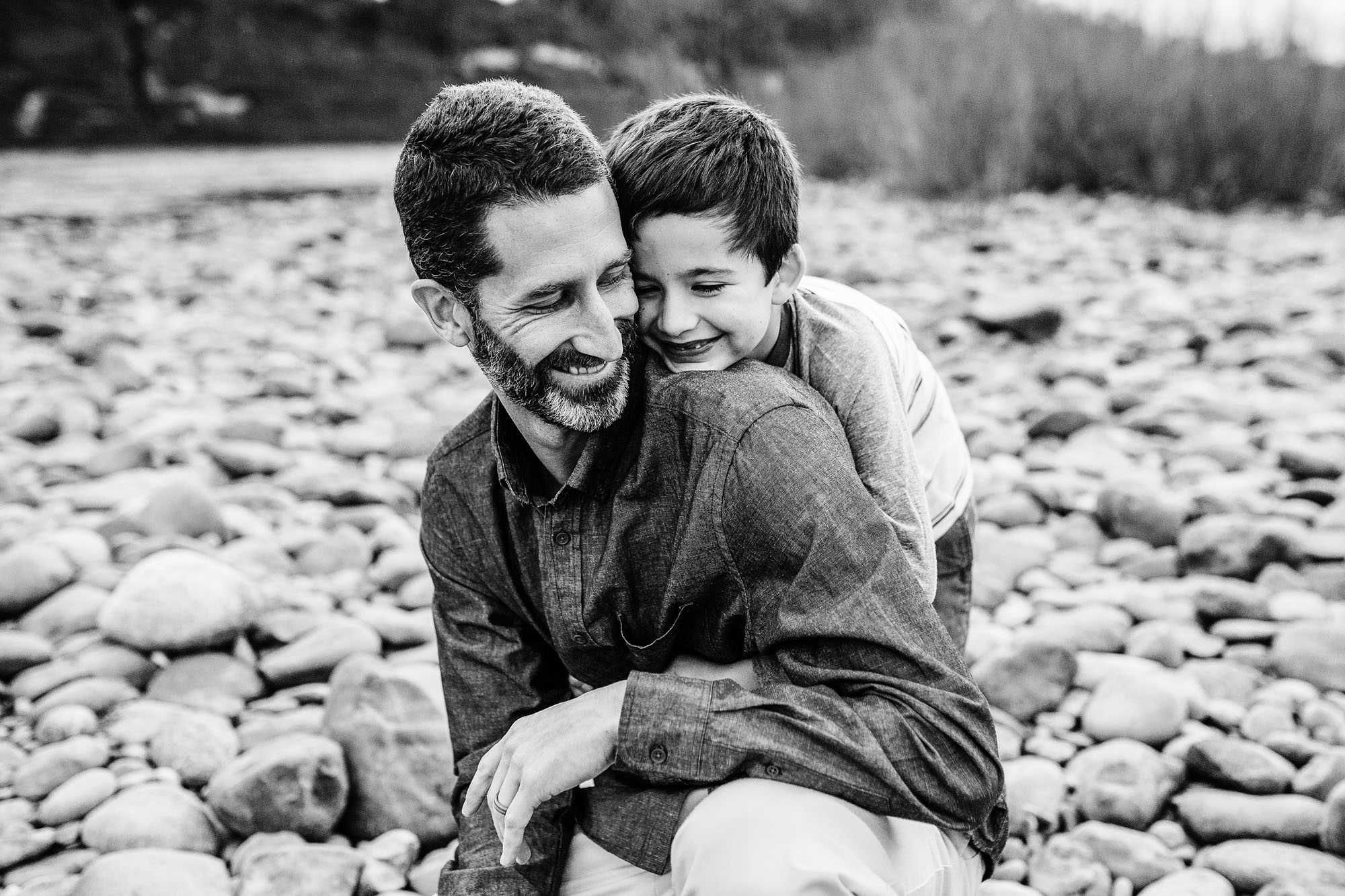 A capture of a father and son happily together during a lifestyle family photo shoot in Sacramento, California with Amy Wright Photography.