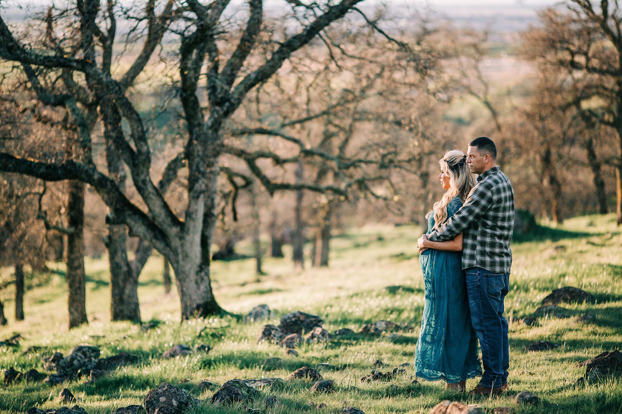 A couple looks out at the view at a park in the Roseville, California area during a maternity photo session wtih Amy Wright Photography.