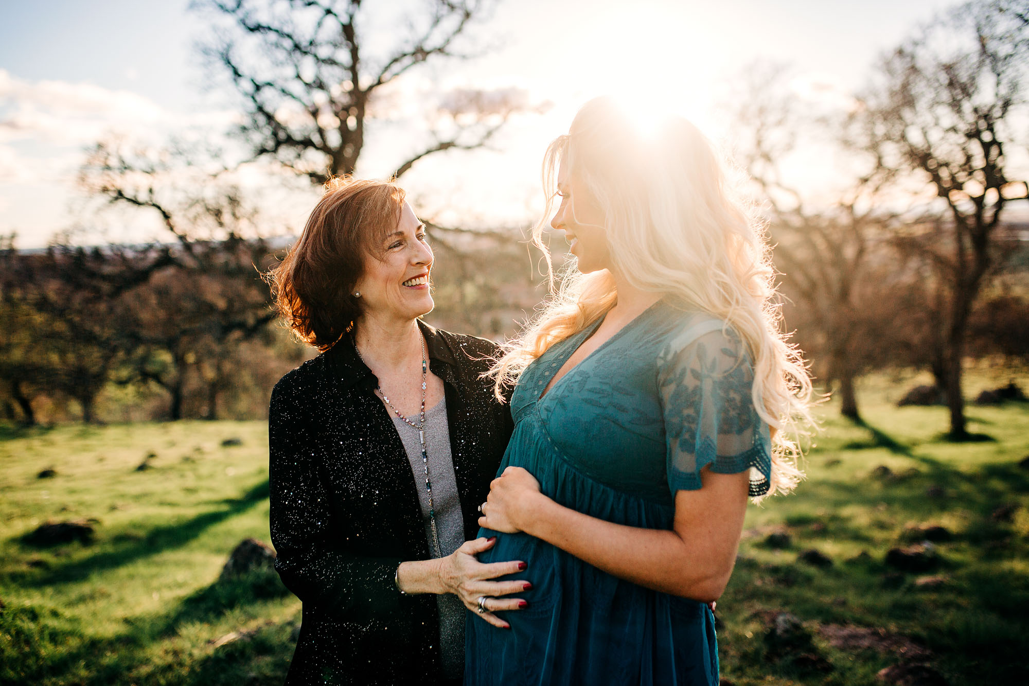A mother and daughter share a special moment during a maternity photo session with photographer Amy Wright, based out of Roseville, California.
