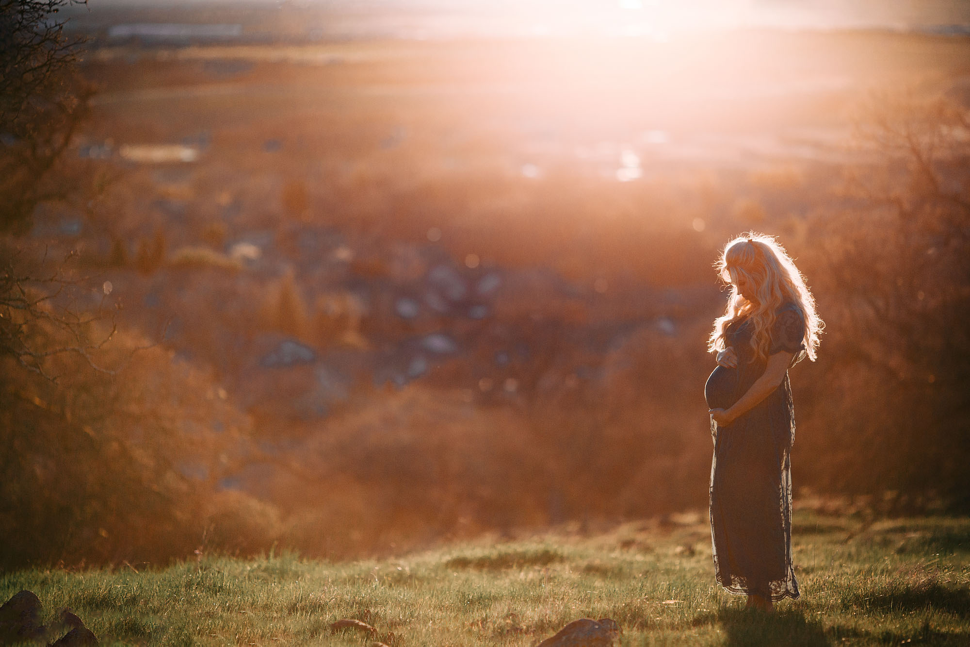 A beautiful, light filled maternity portrait is taken in Rocklin, California with Amy Wright Photography.