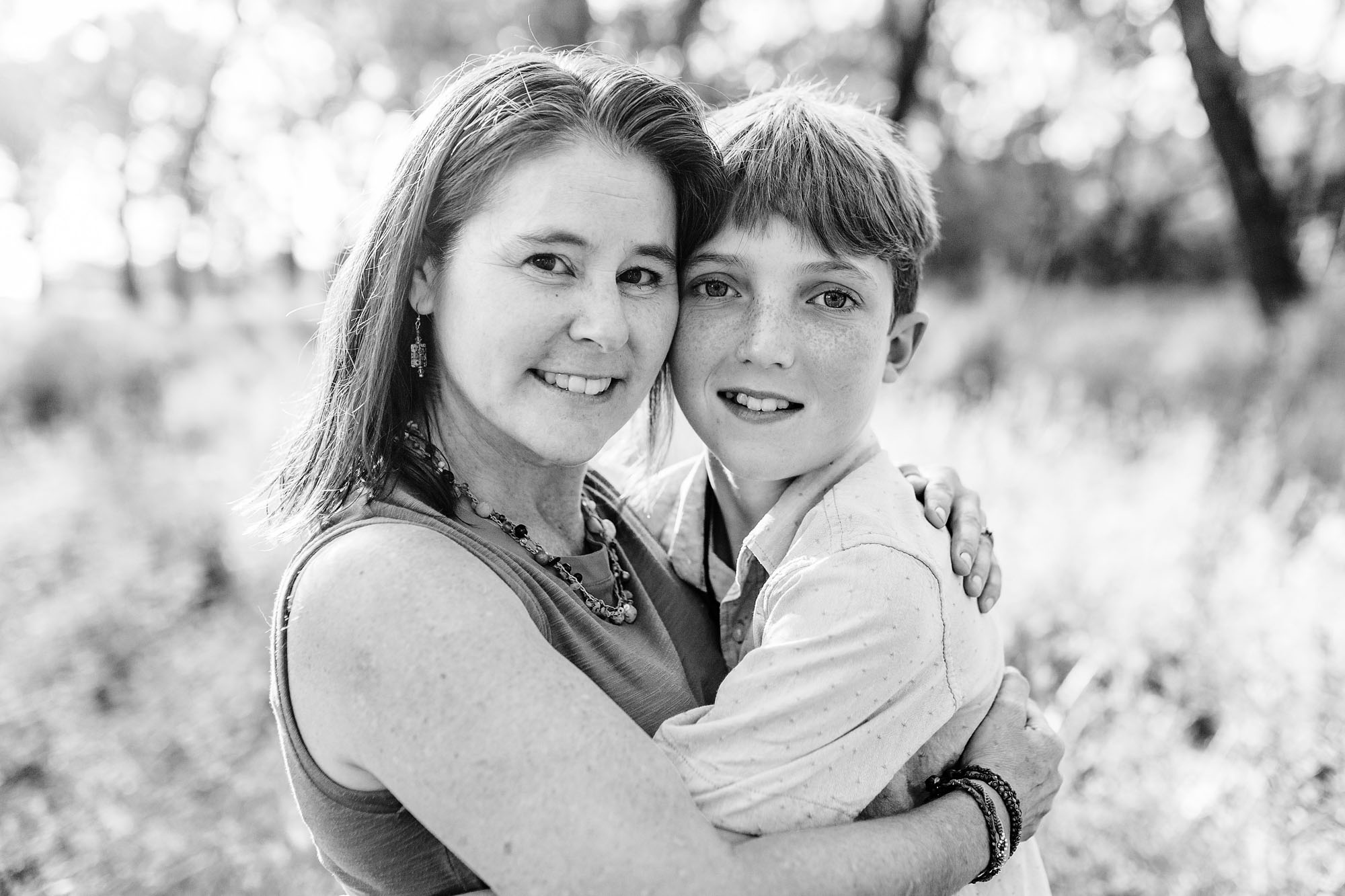 A mother and son embrace during their family photo session with local photographer Amy Wright, in Roseville, California.