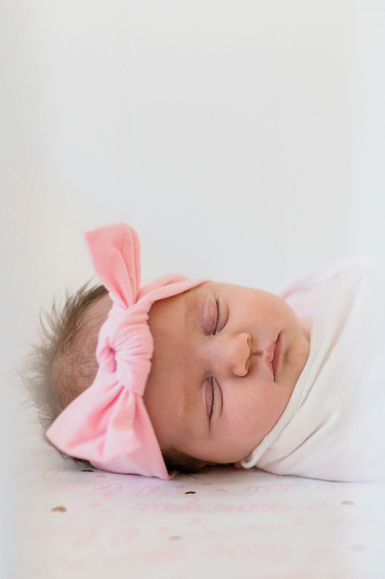 A sweet portrait is taken of a sleeping newborn baby during an in-home newborn photo session with Amy Wright Photography in Roseville, California.