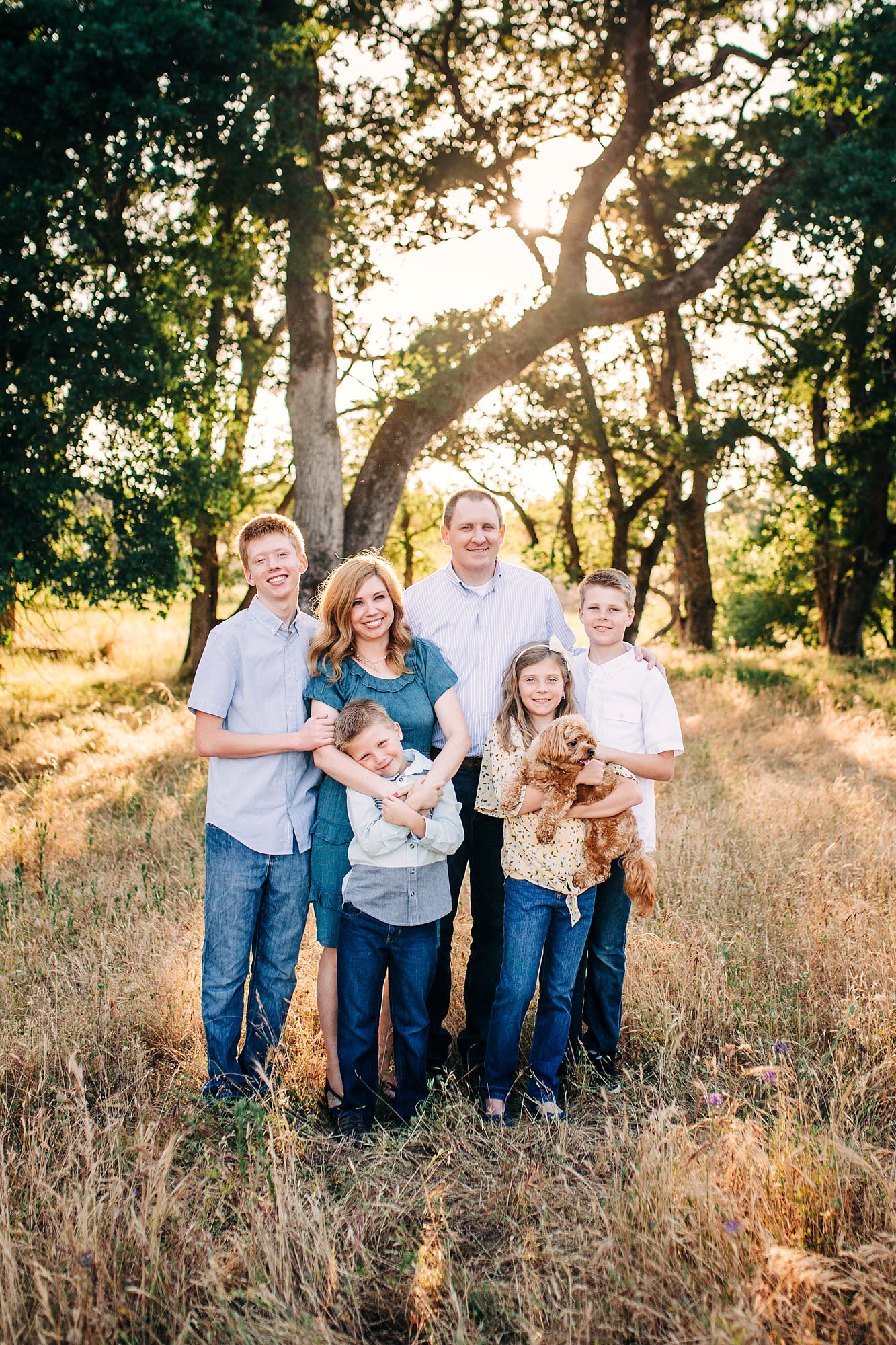 A family and their dog gather together for a lifestyle photo session with family photographer Amy Wright in Roseville, California.