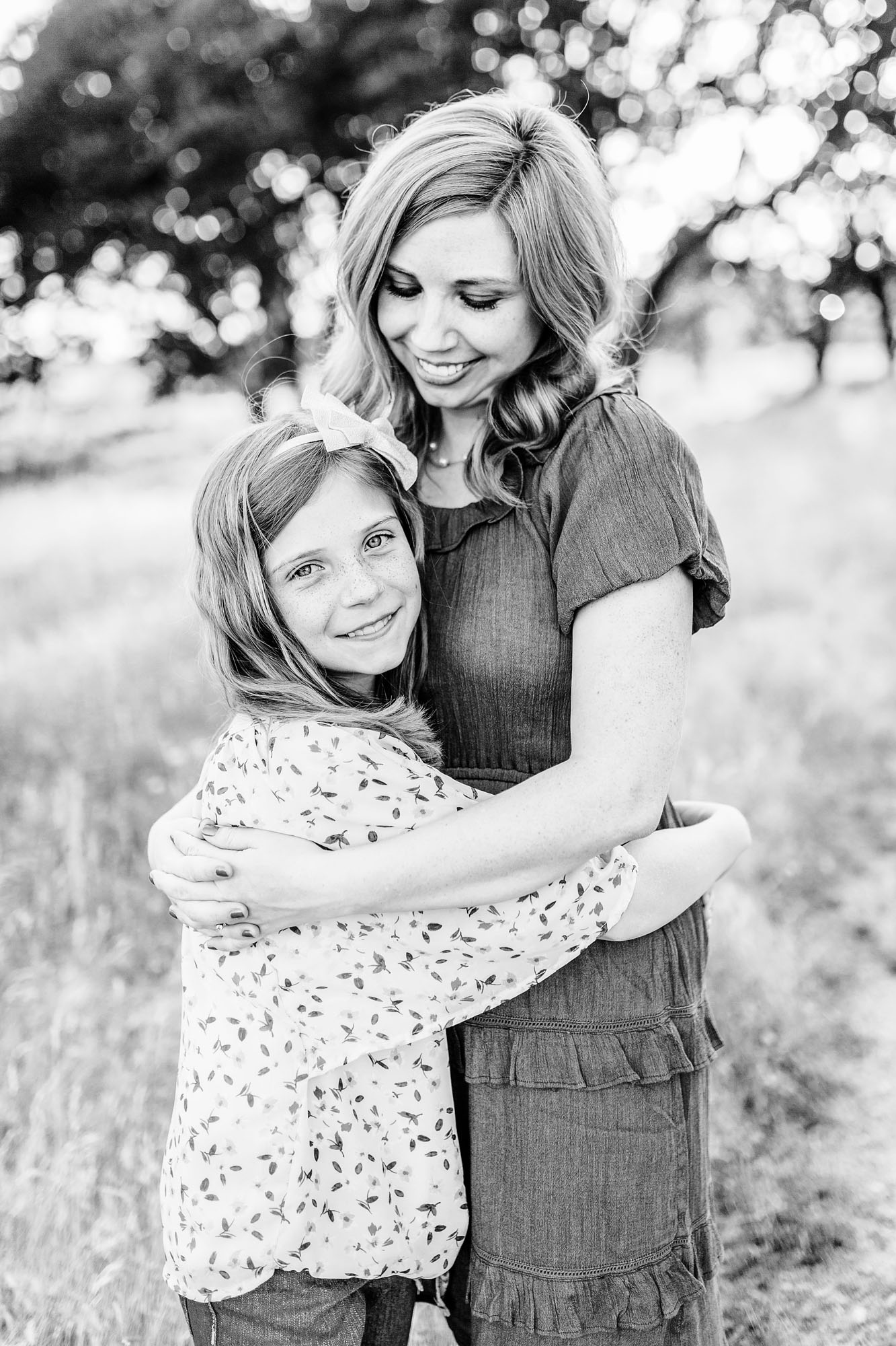 A mother adores her daughter as they share a sweet moment together during a photo session with Roseville family photographer Amy Wright.