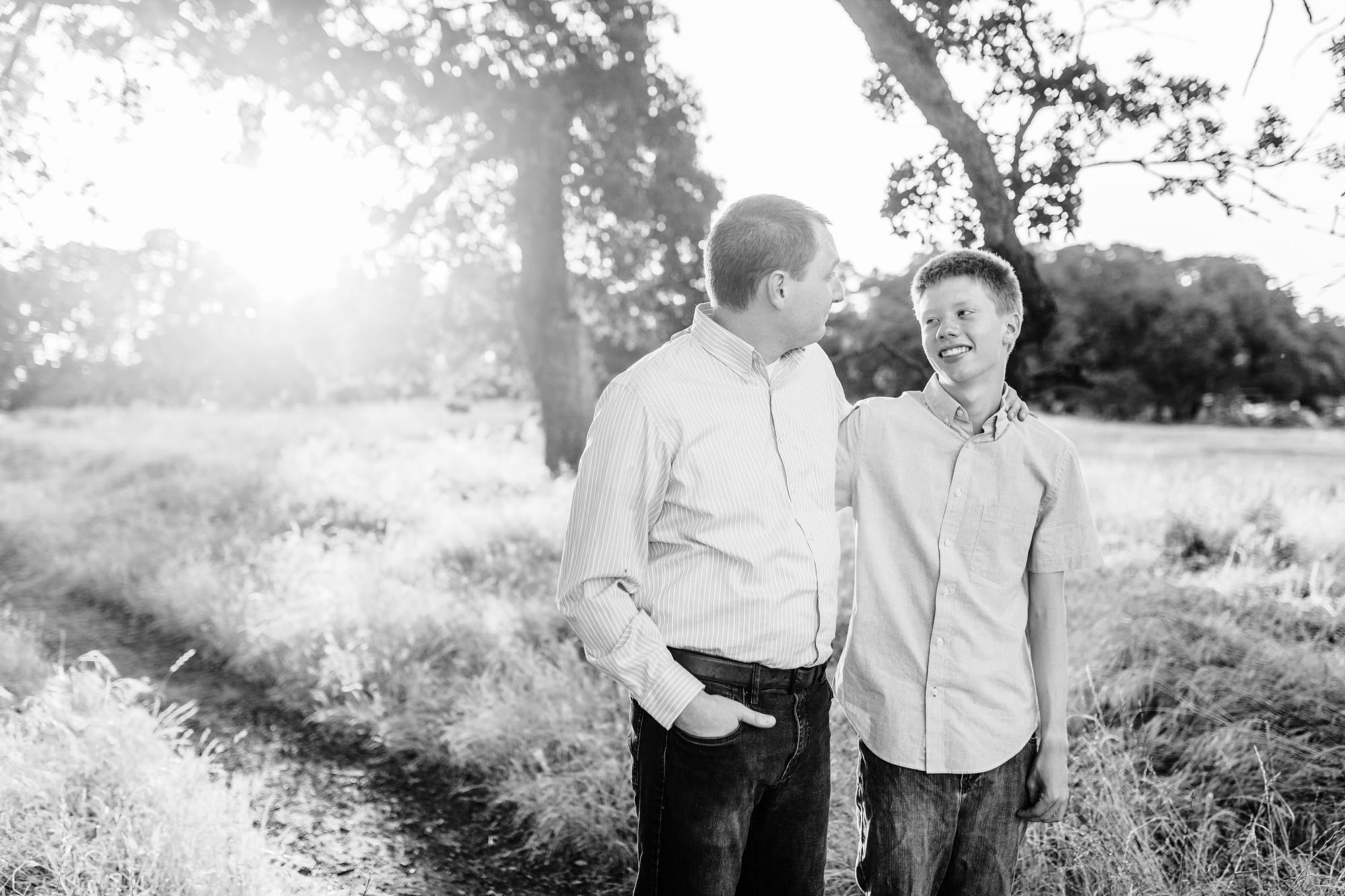 A father and son share a special moment together during family pictures taken by photographer Amy Wright in Roseville, California.