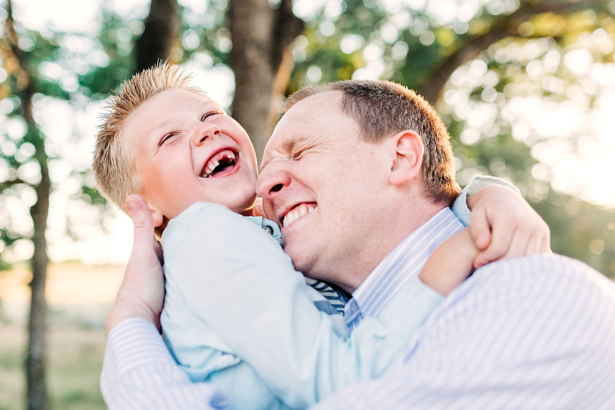 A father and son share a happy moment together during a family photo shoot with photographer Amy Wright in Roseville, California.