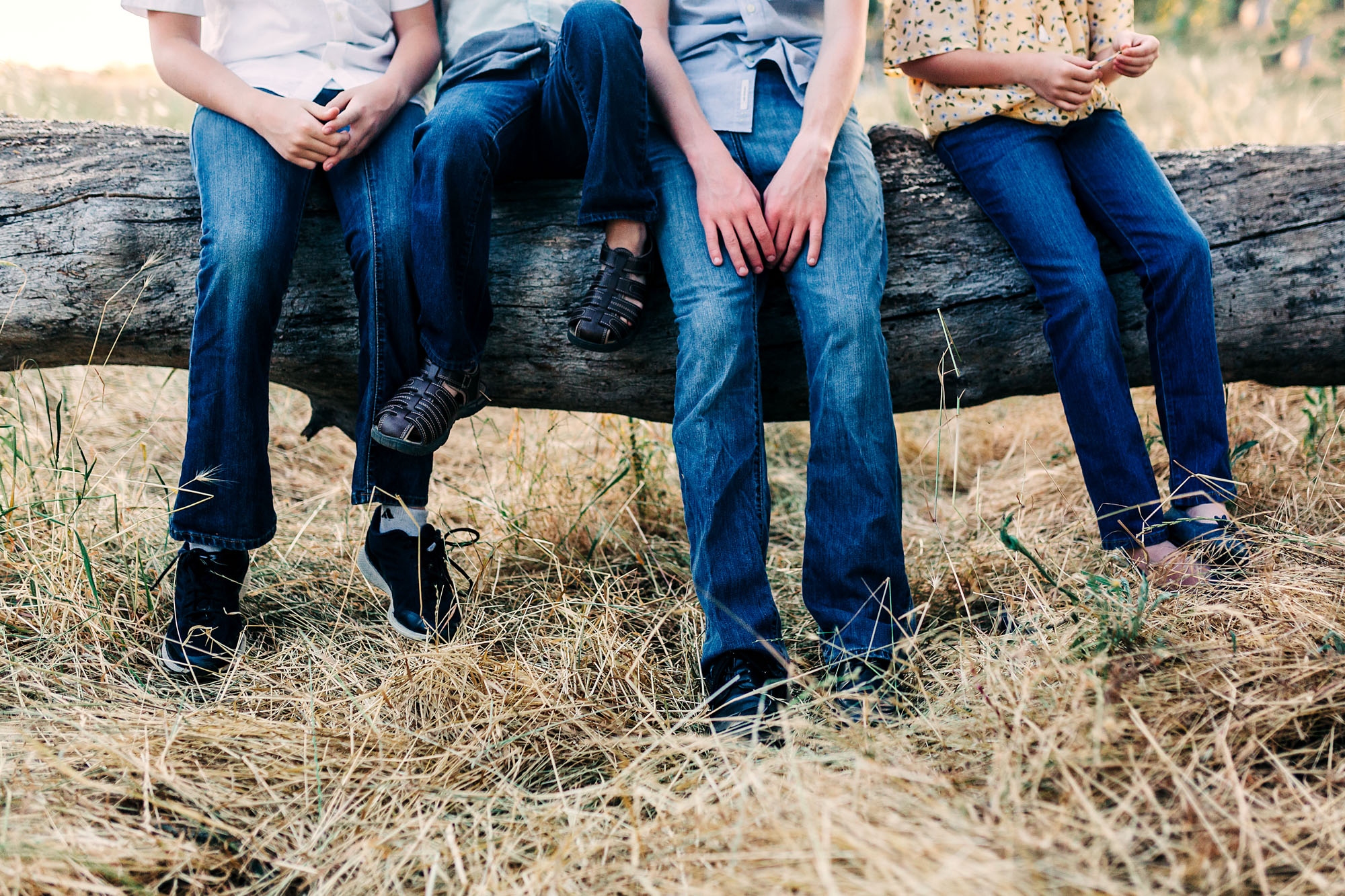 A fun, detail shot is taken of four siblings at a park in Roseville, California with family photographer Amy Wright.