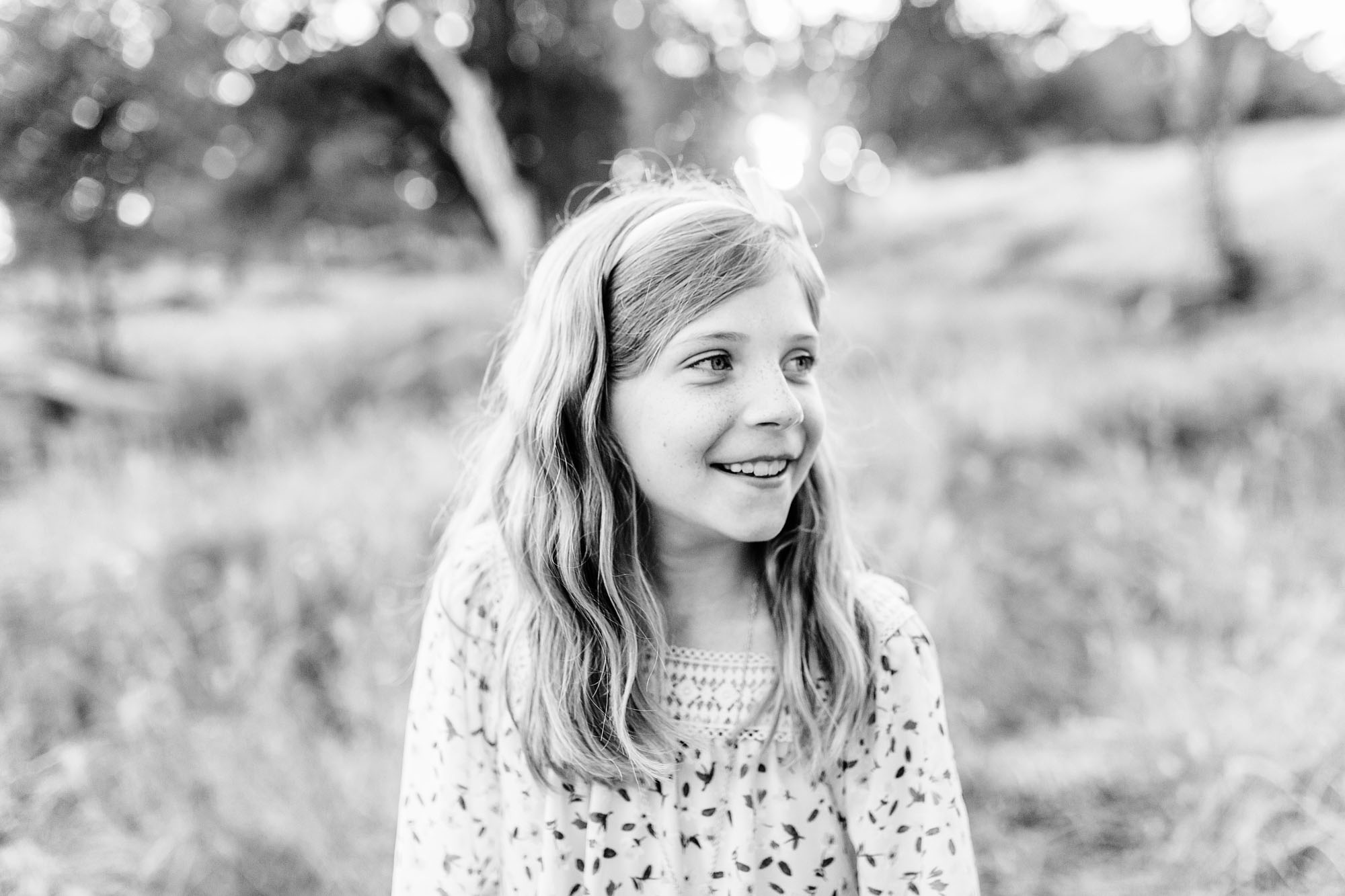 A timeless photo of a young girl taken during family pictures with lifestyle photographer Amy Wright in Roseville, California.