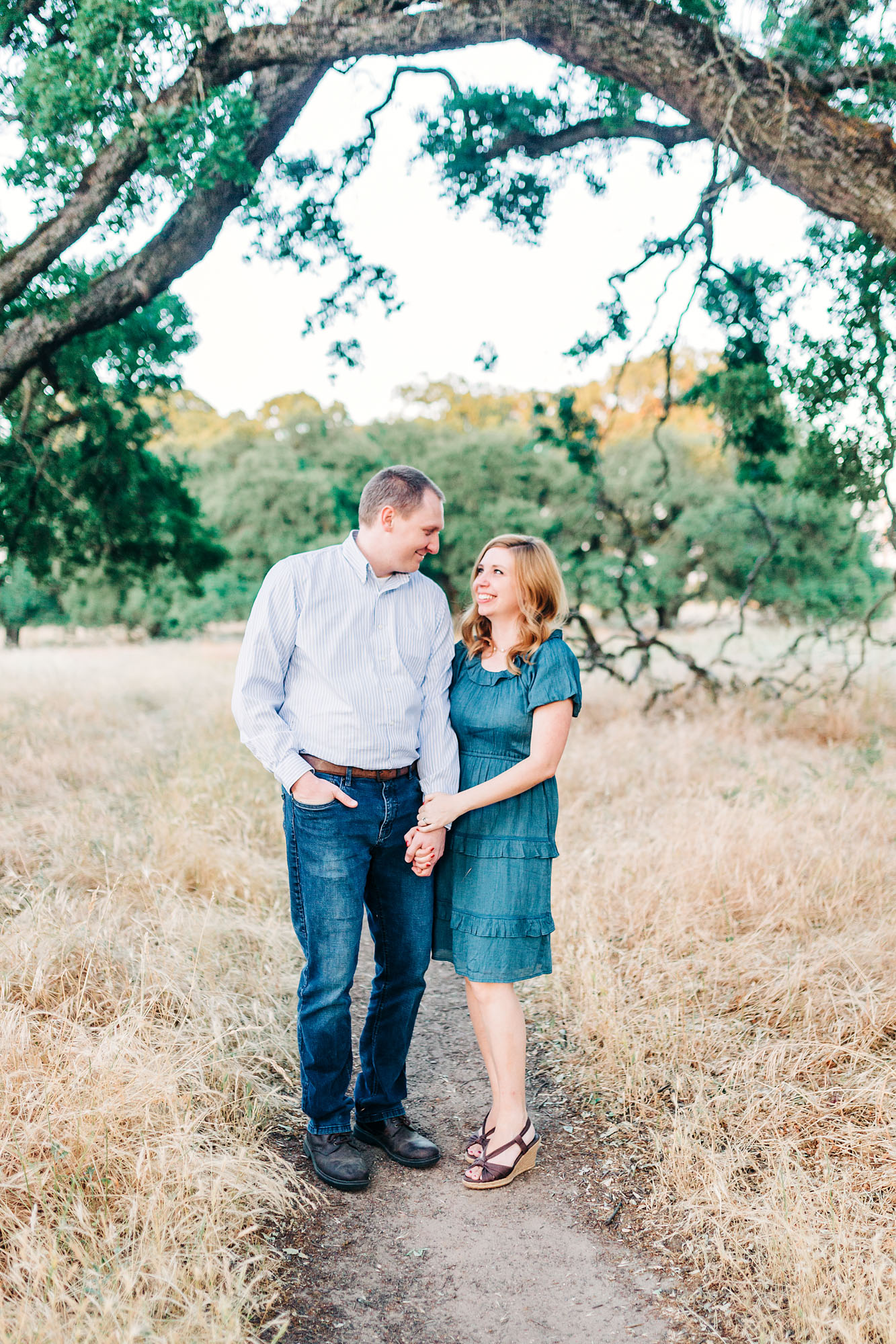 A couple stands together for a beautiful portrait during family pictures with lifestyle photographer Amy Wright in Roseville, California.
