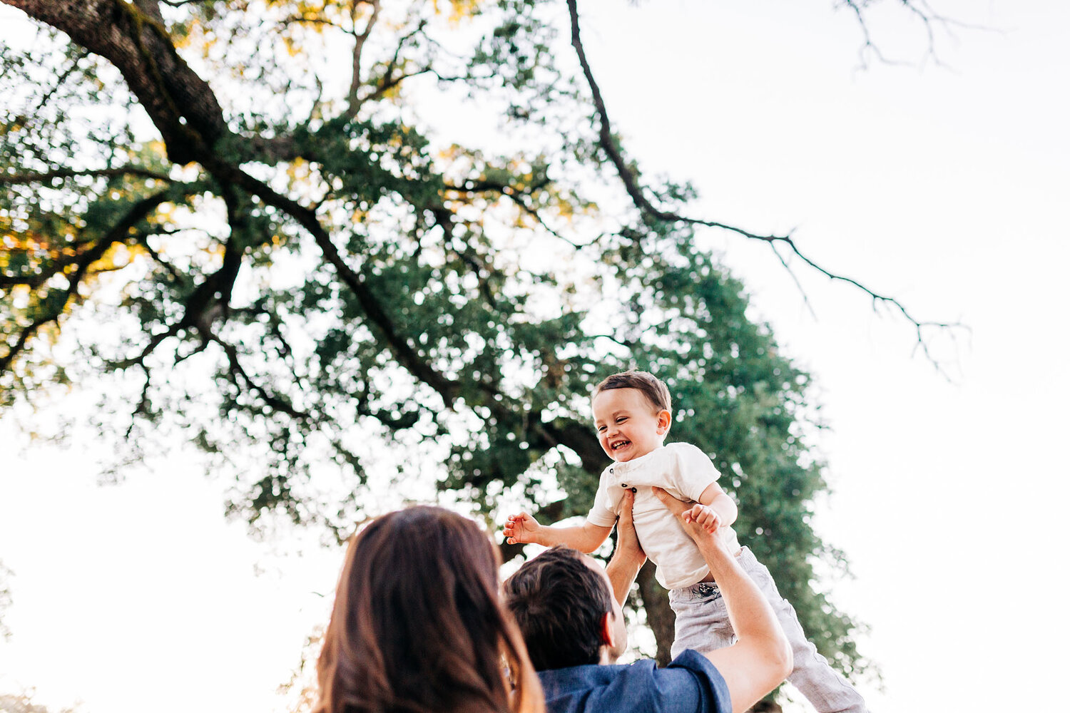 A fun and joyful moment is captured with family photographer Amy Wright, who is based out of Roseville, Rocklin, and Sacramento, California.