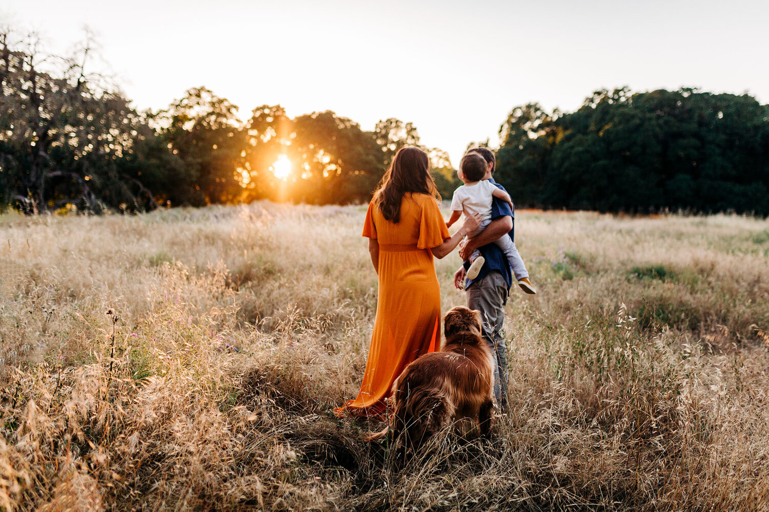A family walks together during a photo session with Roseville maternity photographer Amy Wright.
