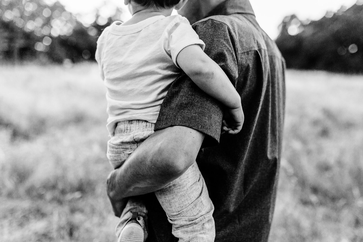 A detailed photo of a father and son is taken during a lifestyle photo session with family photographer Amy Wright in Roseville, California.
