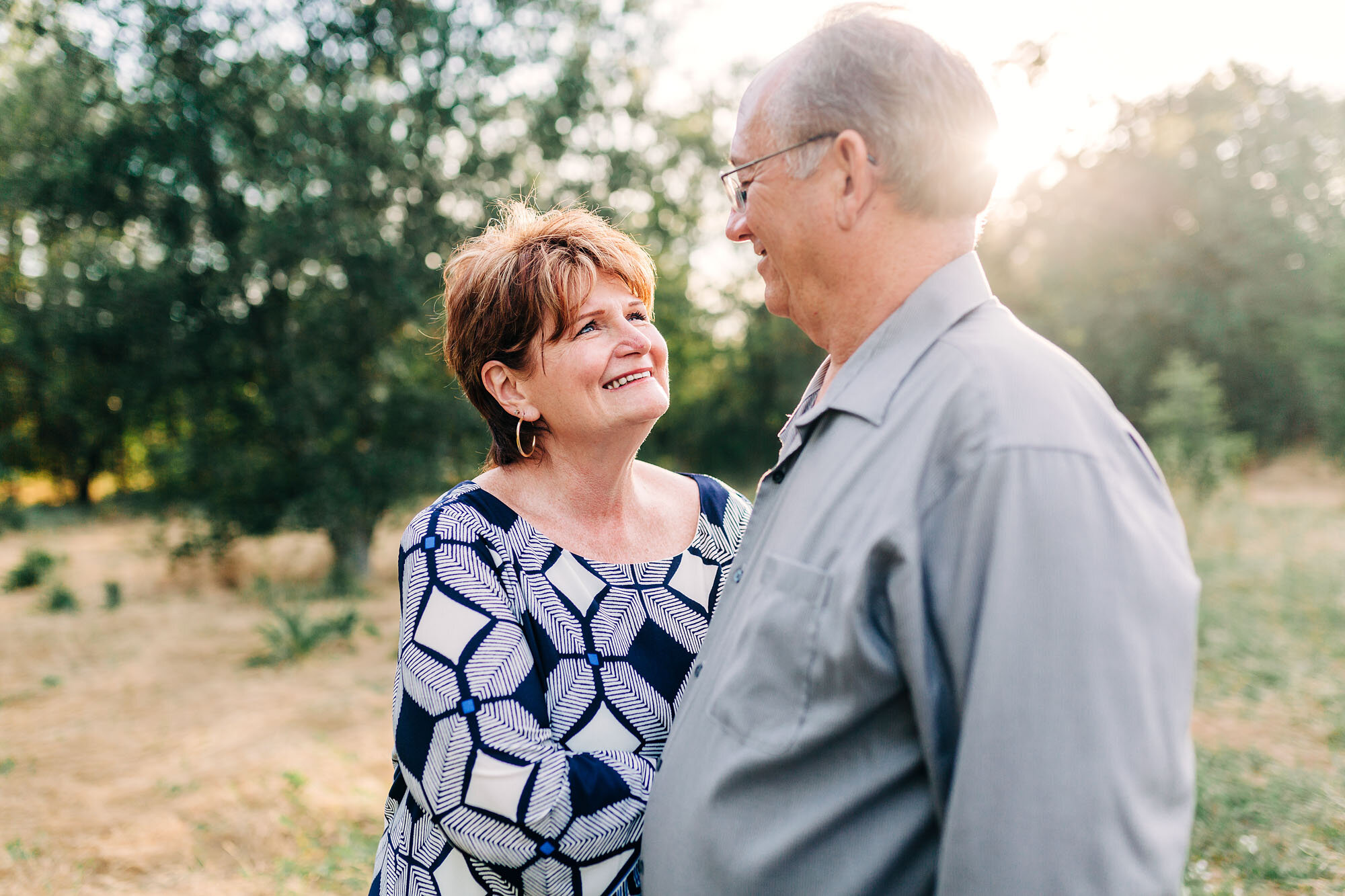 Grandparents get their portrait taken during an extended family photo session with lifestyle photographer Amy Wright in Roseville, California.