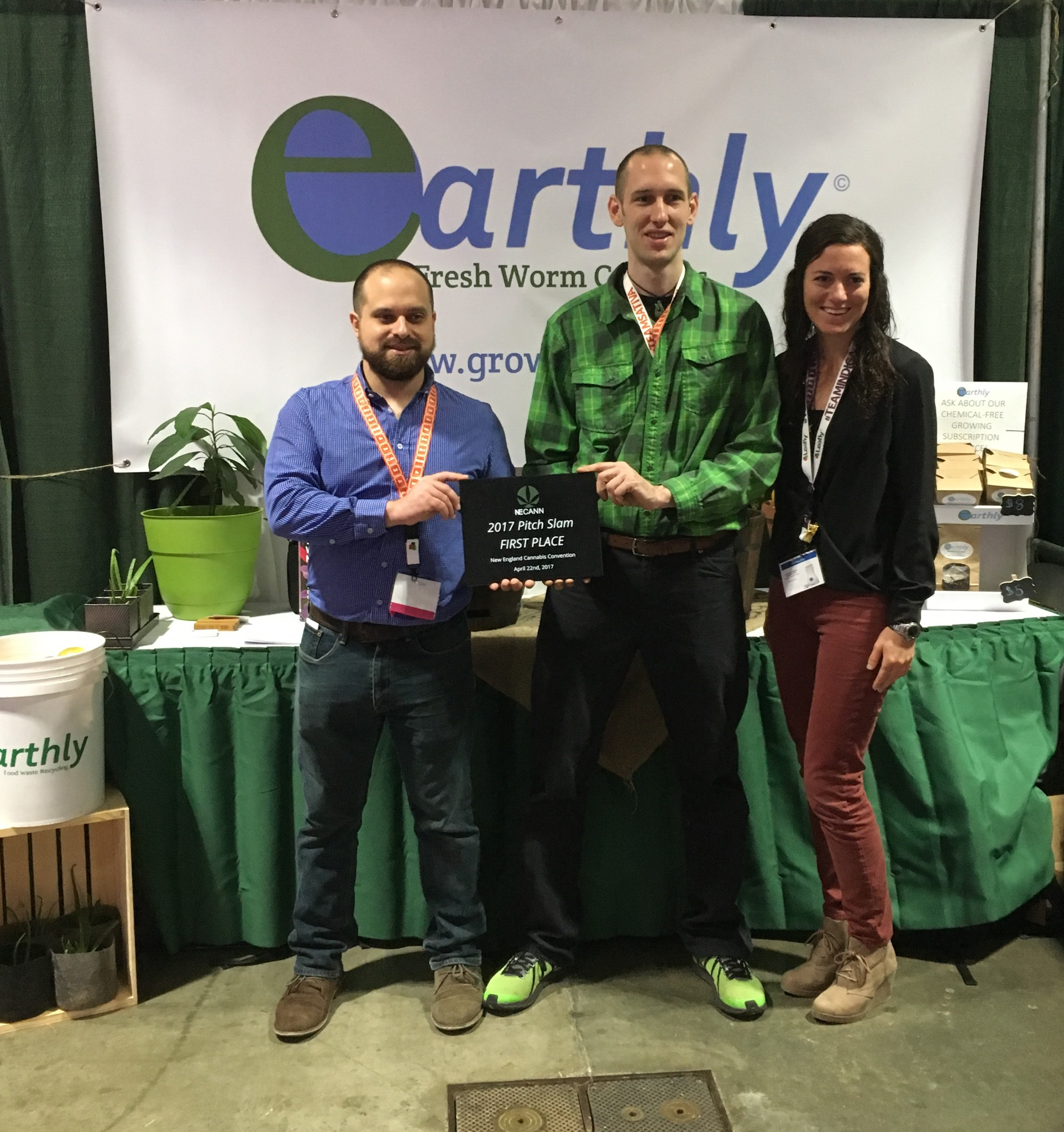 Earthly team members Frank Mastrobuono,Mike Kowalczyk, and Sandy Moskovitz pose with their First Place award plaque after the first annual NECANN Pitch Slam, held and Hynes Convention Center in Boston, MA on April 22, 2017
