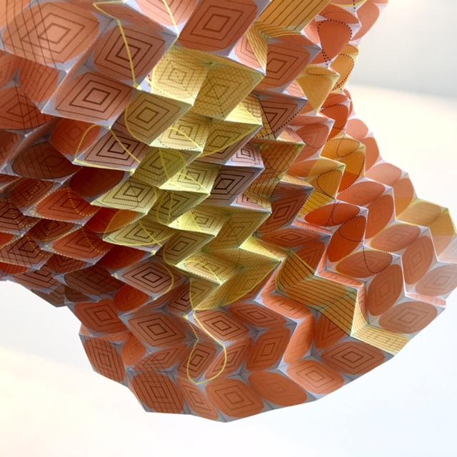 "The Sea Fan   2015, hand-folded acid free paper, filament line, gravity,  34 x 34 x 34"""
