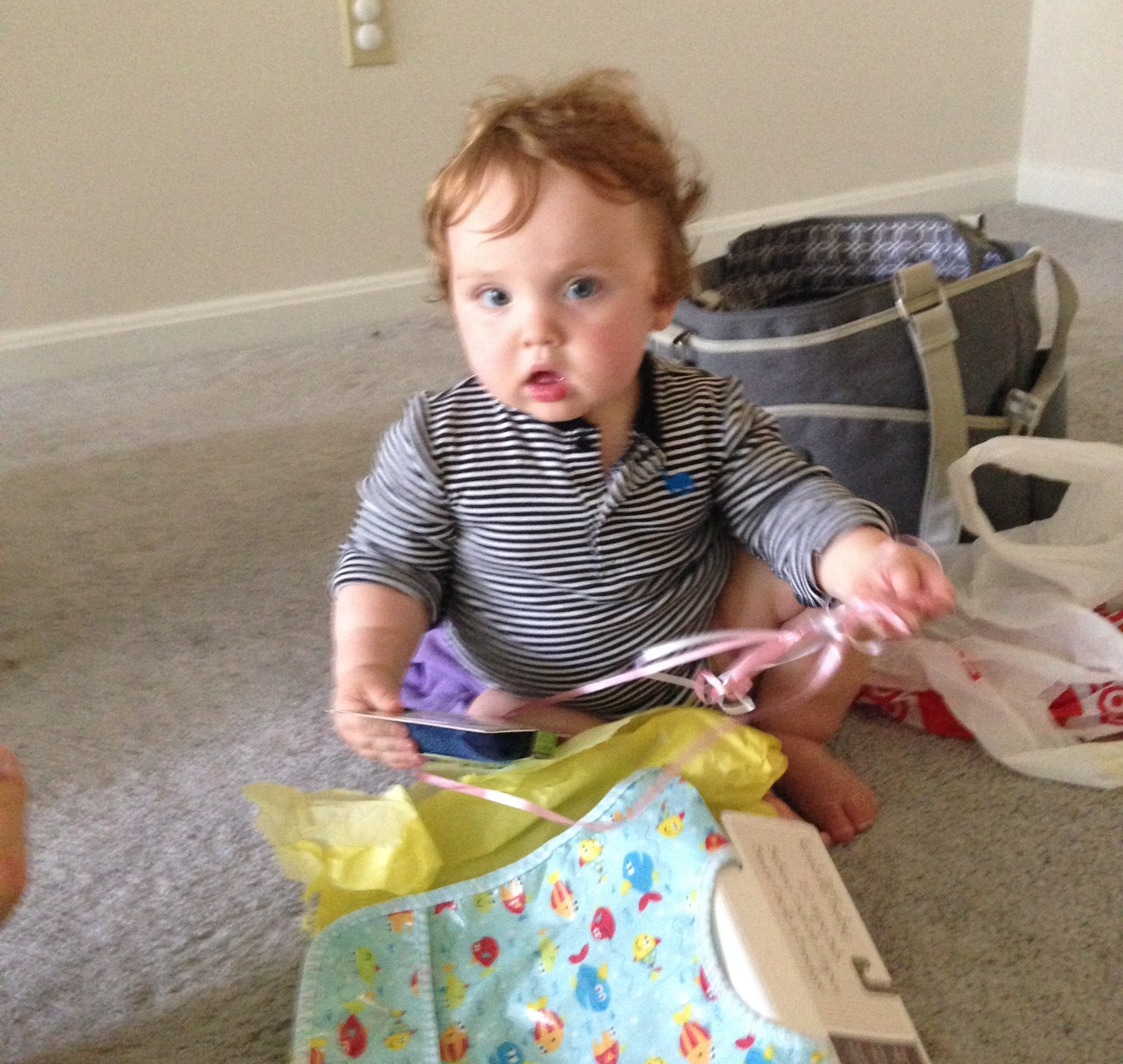 Your first birthday was the day we moved into our apartment with no furniture (and no idea where it was or when it was coming). You got to play with colorful paper and eat a cupcake, so you seemed generally all right.