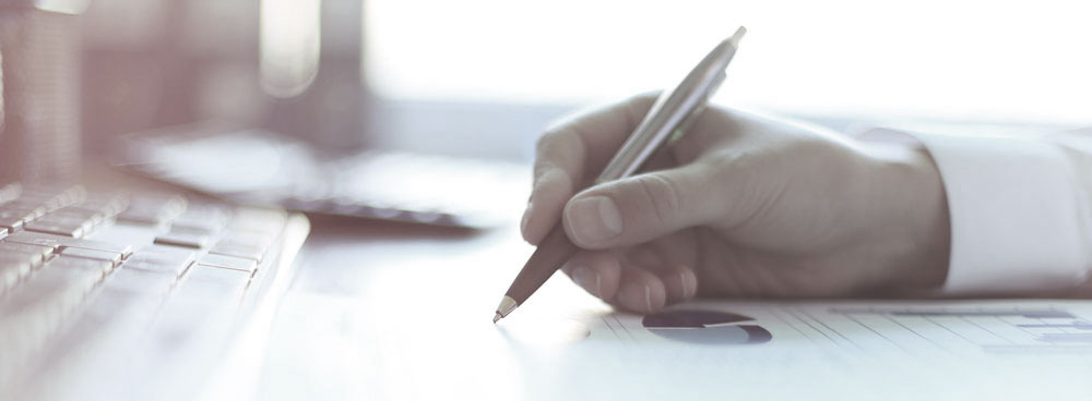 Businessman writing a report- Cameron Poetzscher's Biography