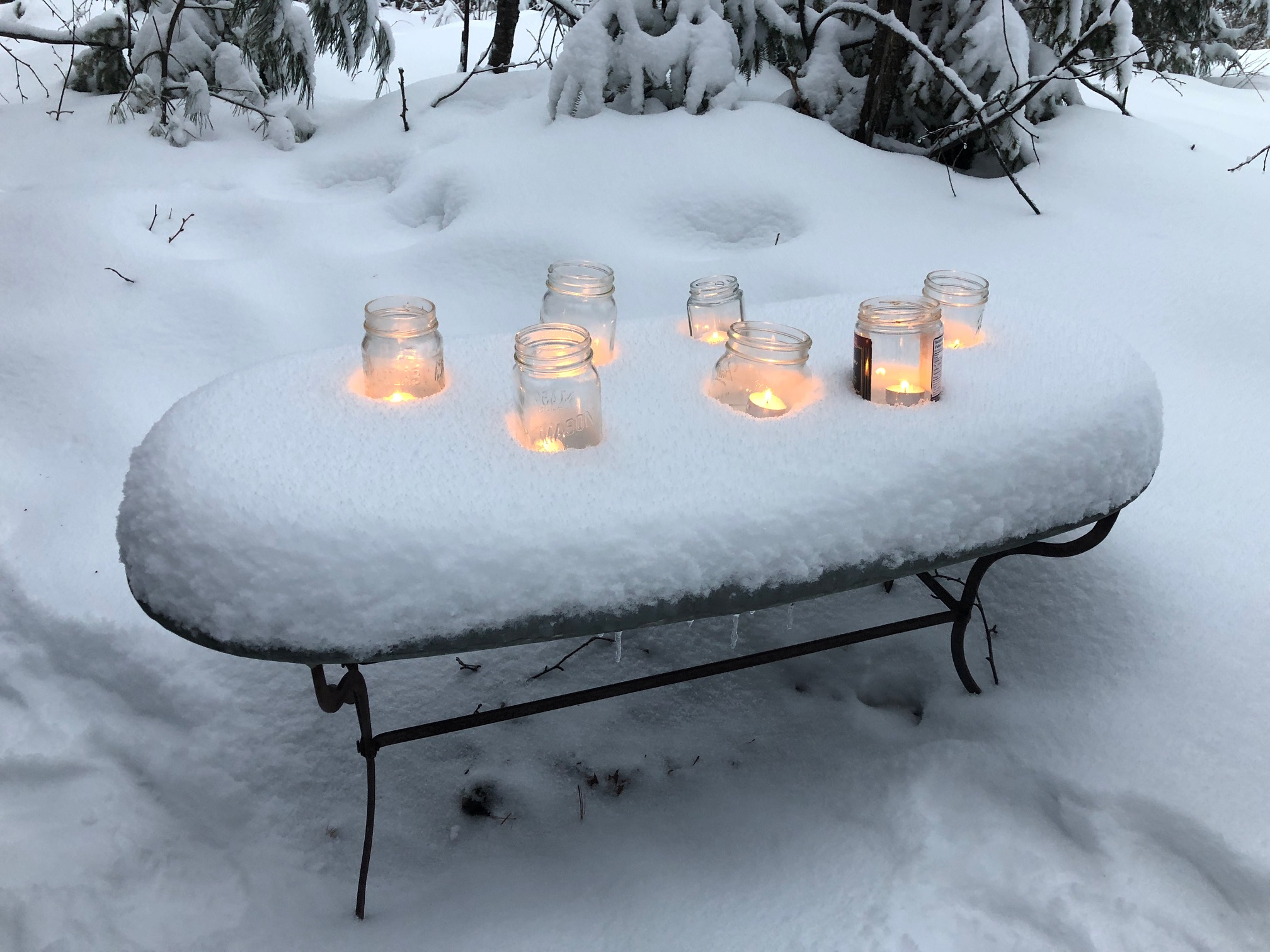 Candles on table in snow 2019.JPG