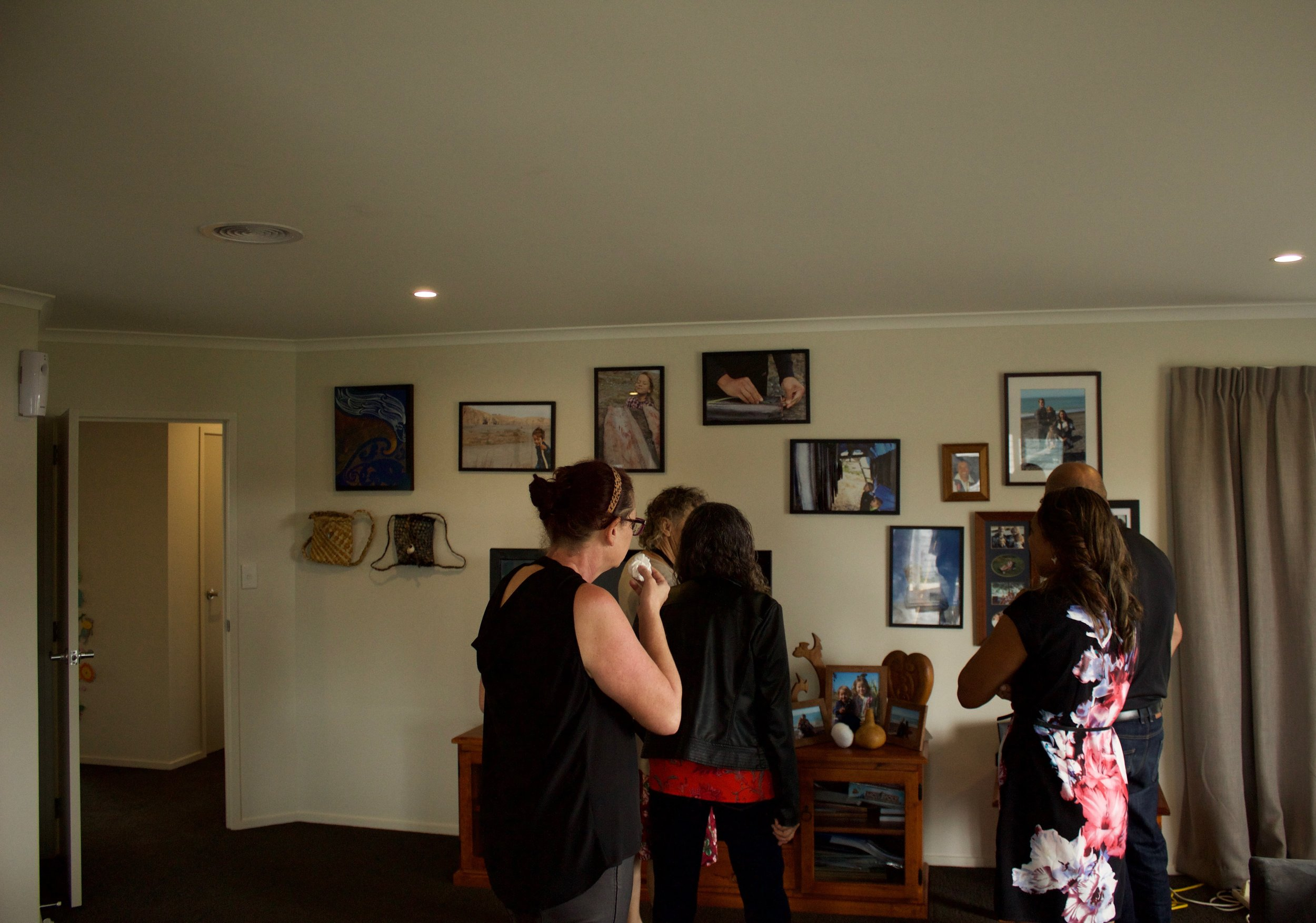 Hinewai shows visitors through one of the homes at Te Piringa Papa Kāinga