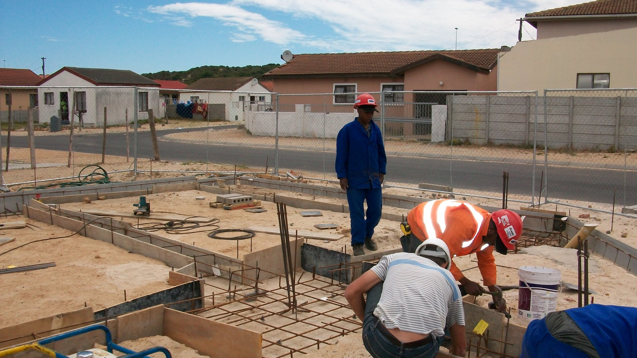 laying beams to foundation.JPG