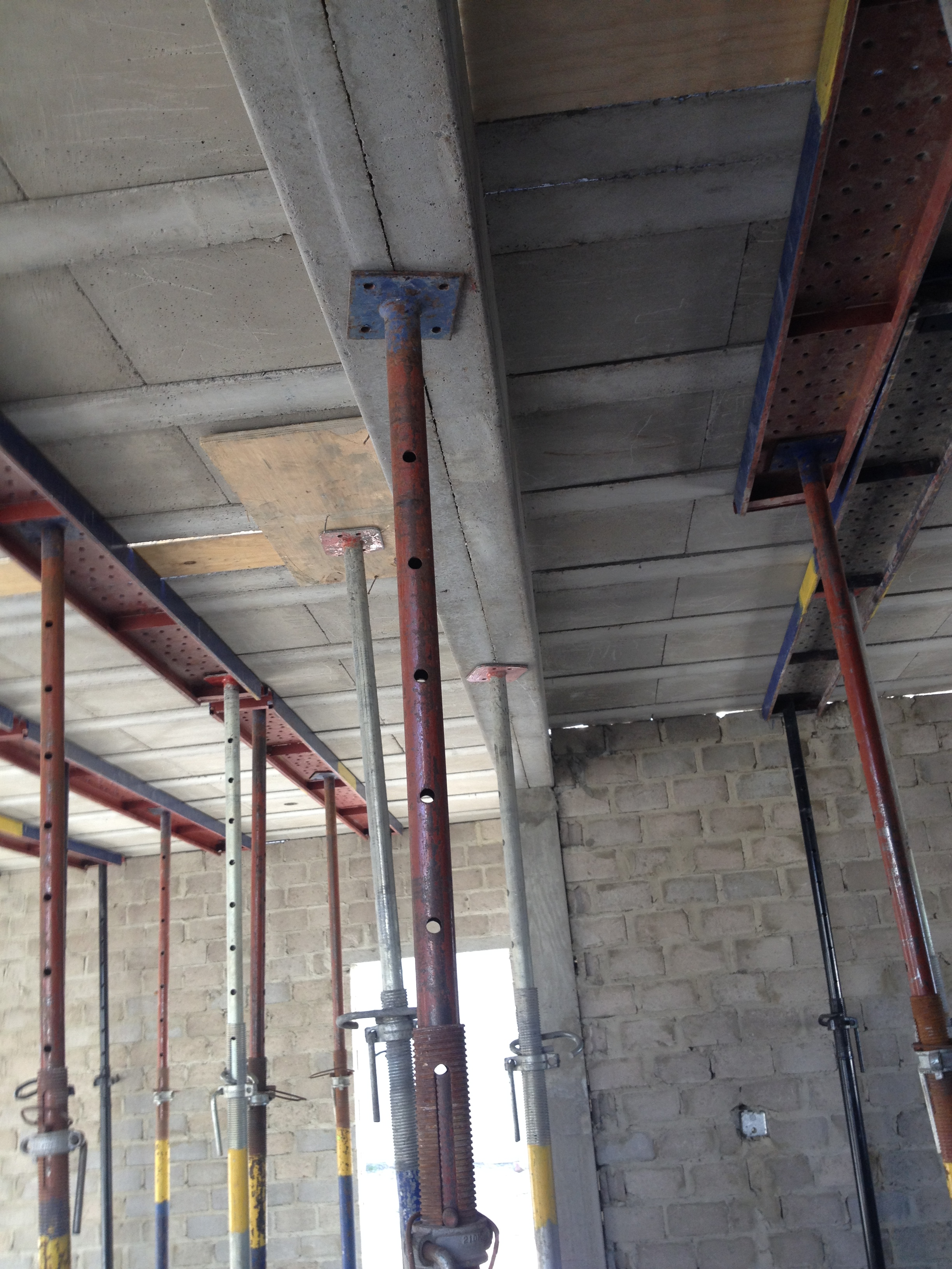 Shuttering in position for beams and slab