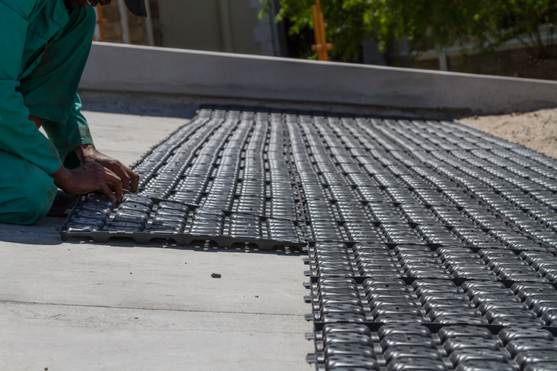 Besides offering easy installation, the modular panels store water in their supporting feet.