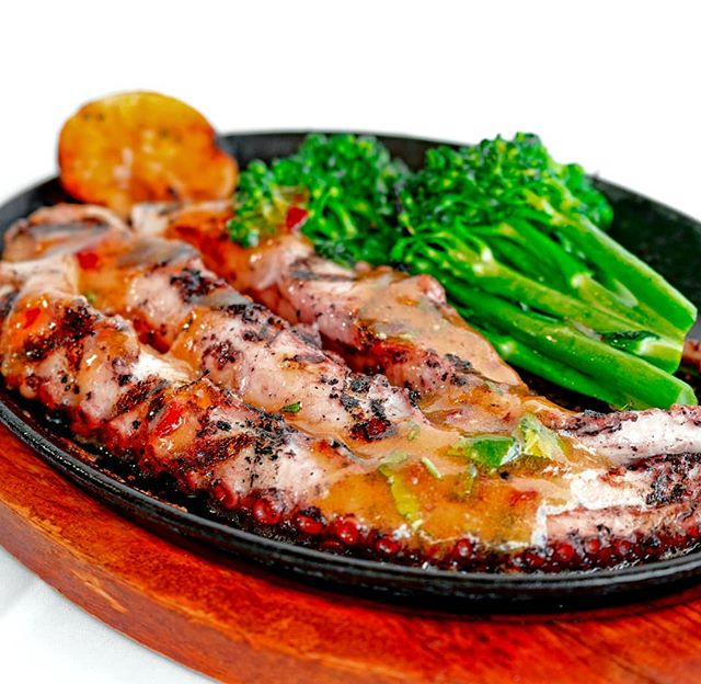 Full of flavor and grilled to perfection, our Octopus Grilled Skillet with Broccolini is a must try when visiting us.  Since 1989 we have been in the forefront of Cuban Cuisine.  RSVP: www.yuca.com or click reservation link in bio  #yucamiami #octopus #appetizers #dinner #maincourse #seafood #instafood #miamibeach #drinks #cubandishes #saturday #mojito