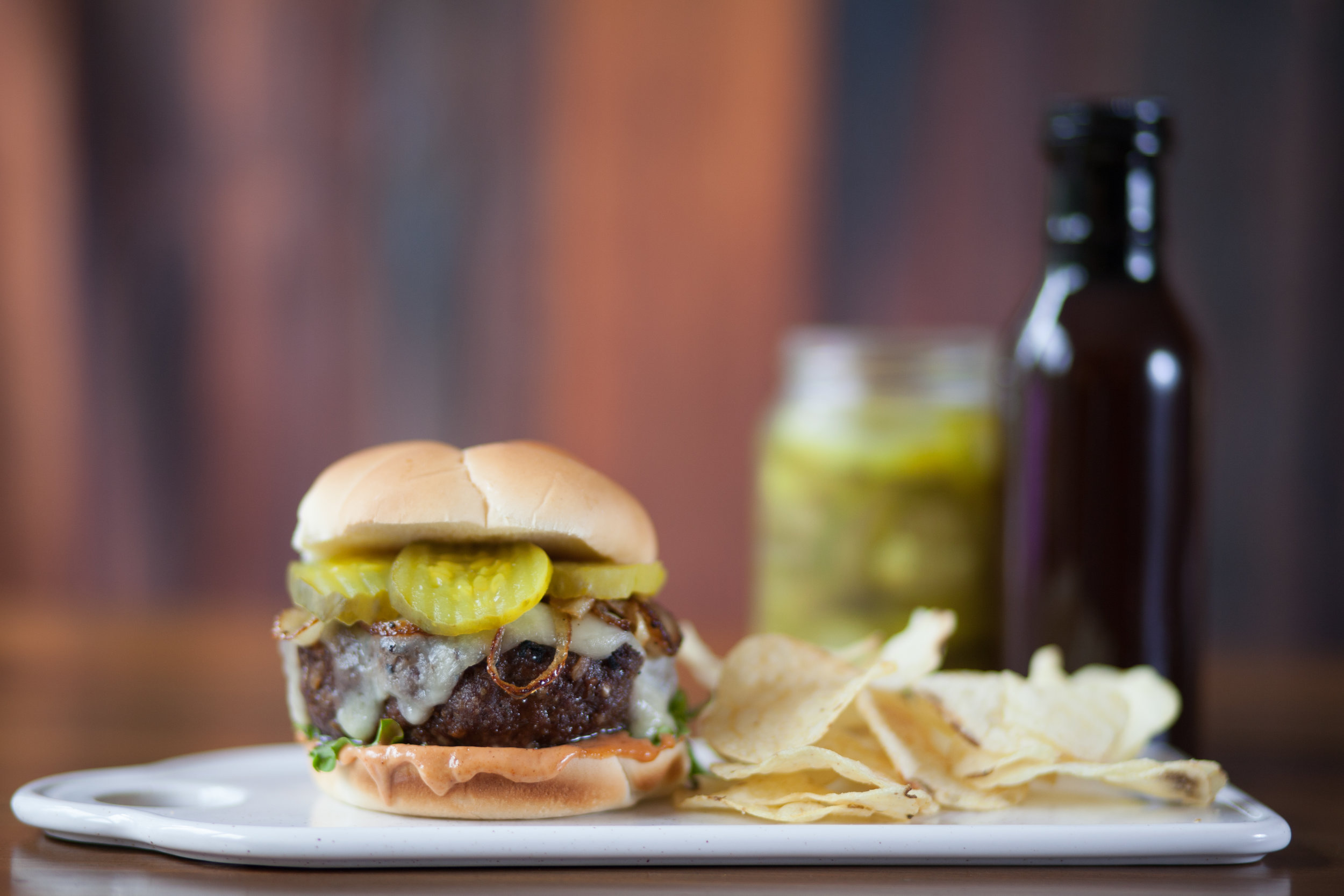 French Onion Burger with Chips - The salty, cheesy satisfaction of a French onion soup...but on a burger. Packed between the full-flavored Aunt Millie's Hearth Classic Hamburger buns. It just has that certain 'je ne sais quoi' about it.