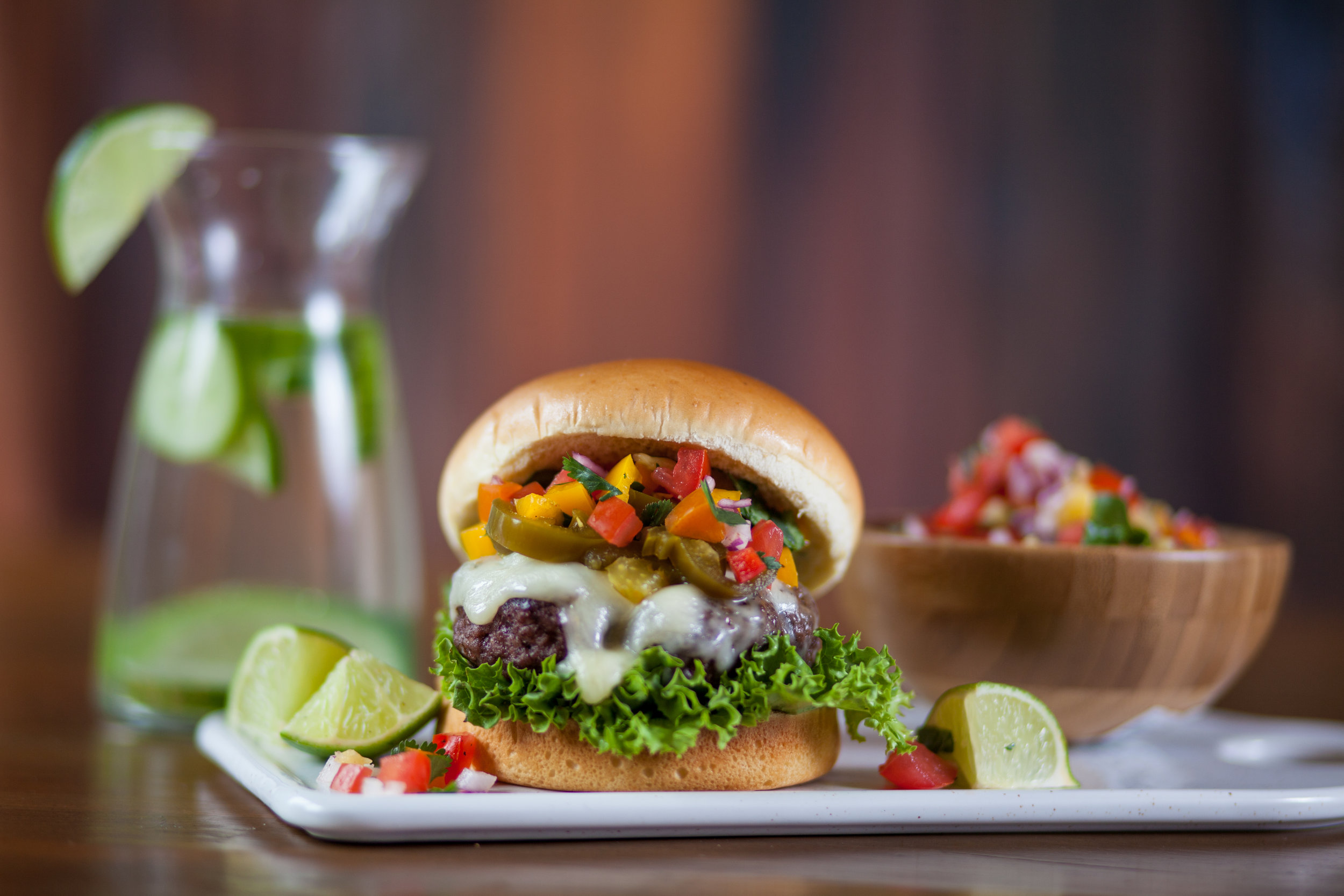 Grilled Jalapeño Pico Burger - Bringing the heat with this burger! The Jalapeño Pico burger isn't for the faint of heart. Fresh jalapeño slices and pico de gallo make this a very fresh treat with a bit of heat.
