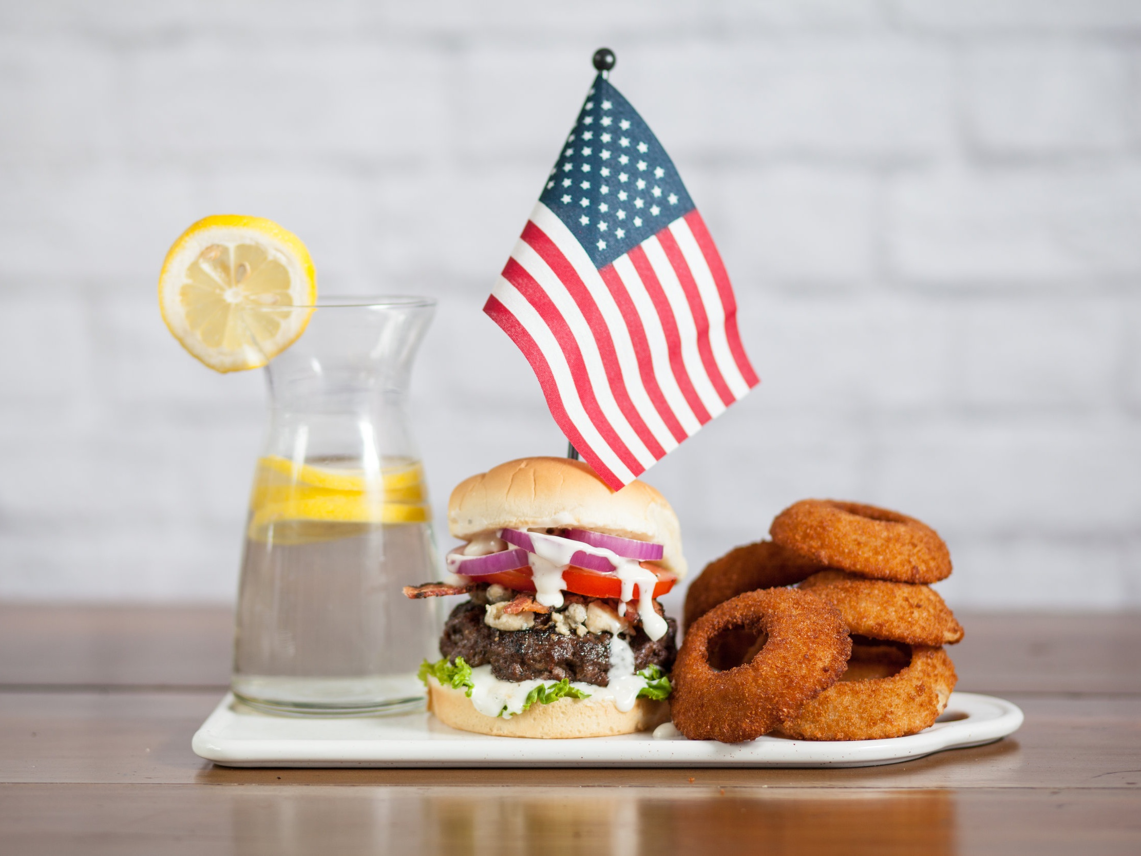 Red, White & Blue Burger - A colorful burger to complement the colors of the holiday. With bacon, ranch and blue cheese creating a savory, juicy and dang ol' good burger. Who knew patriotism could taste so good?