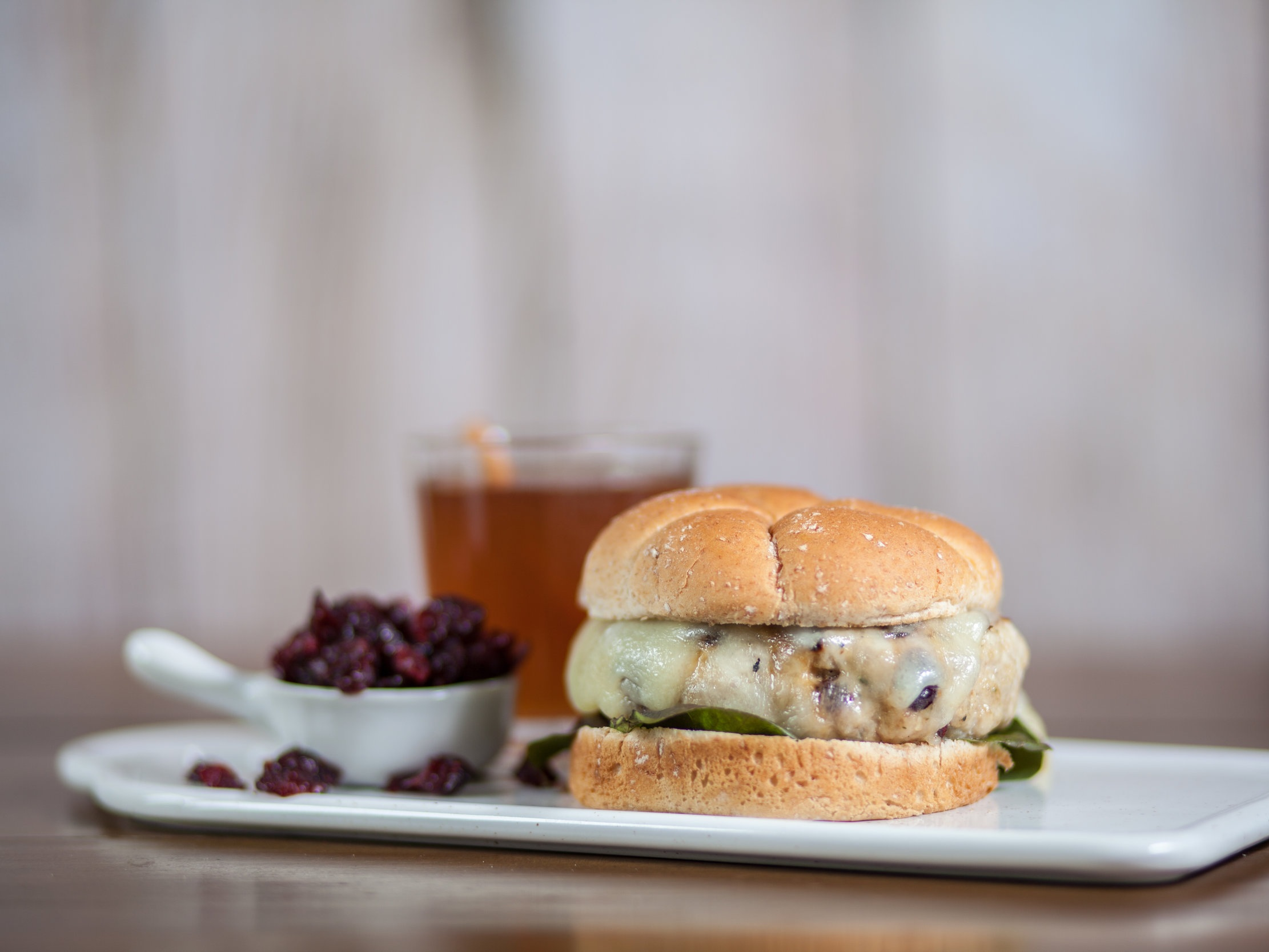 Cranberry Chicken Burger - We can't help but feel totally fancy when we make these burgers. On our Hearth Whole Grain Hamburger Buns, this chicken burger is decadent tasting! Like, if expensive had a taste, it would taste like this, but it isn't expensive. Win-win-win all around.