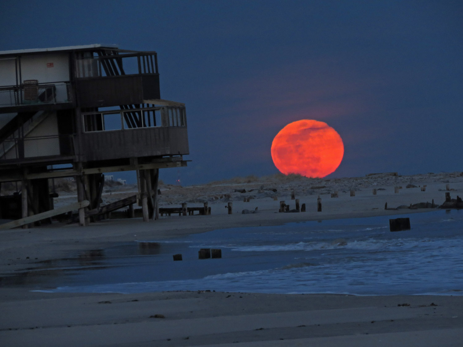 Super snow moon over the beach at Fort Tilden, seen from near the Silver Gull Beach Club at Breezy Point.