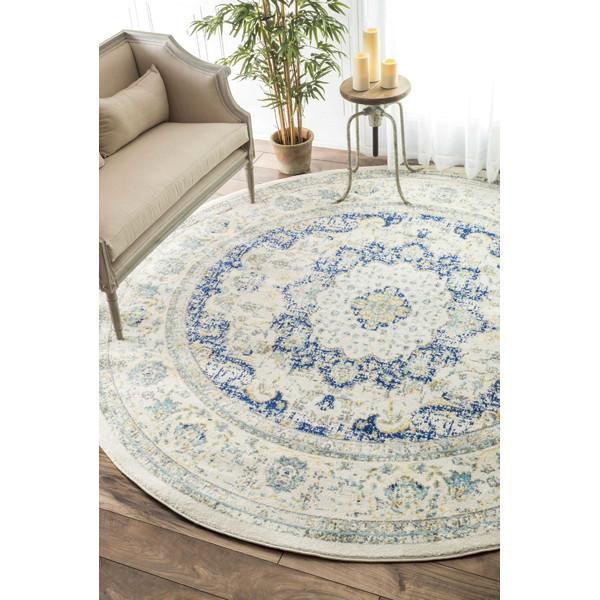 Floral rug over barnwood plank flooring