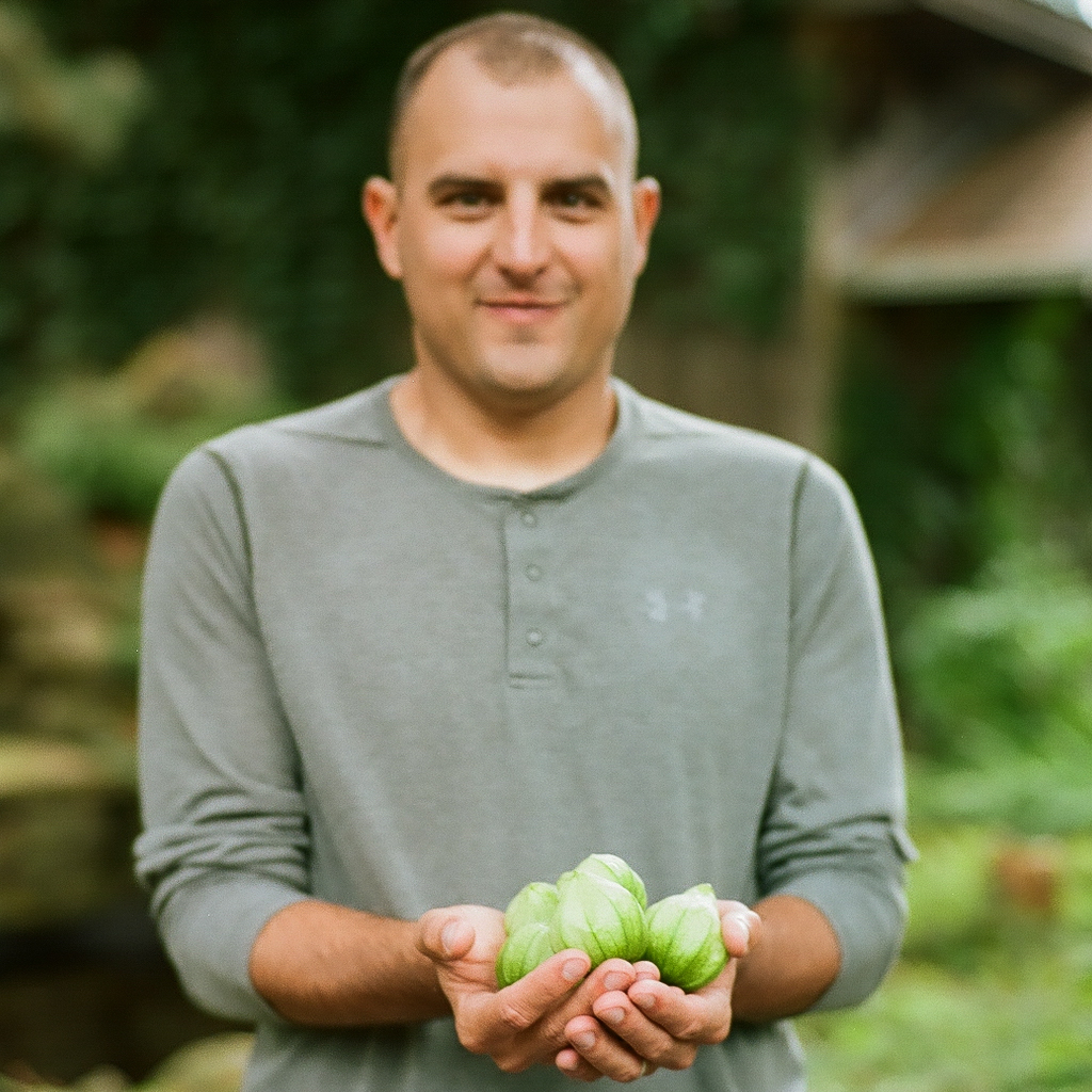 9. husband and first produce of the season, home. leica m6 + zeiss sonnar & portra 160, the darkroom lab.