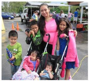 "Rosalba ""Rosa"" Roman and children shopping at the KFM"