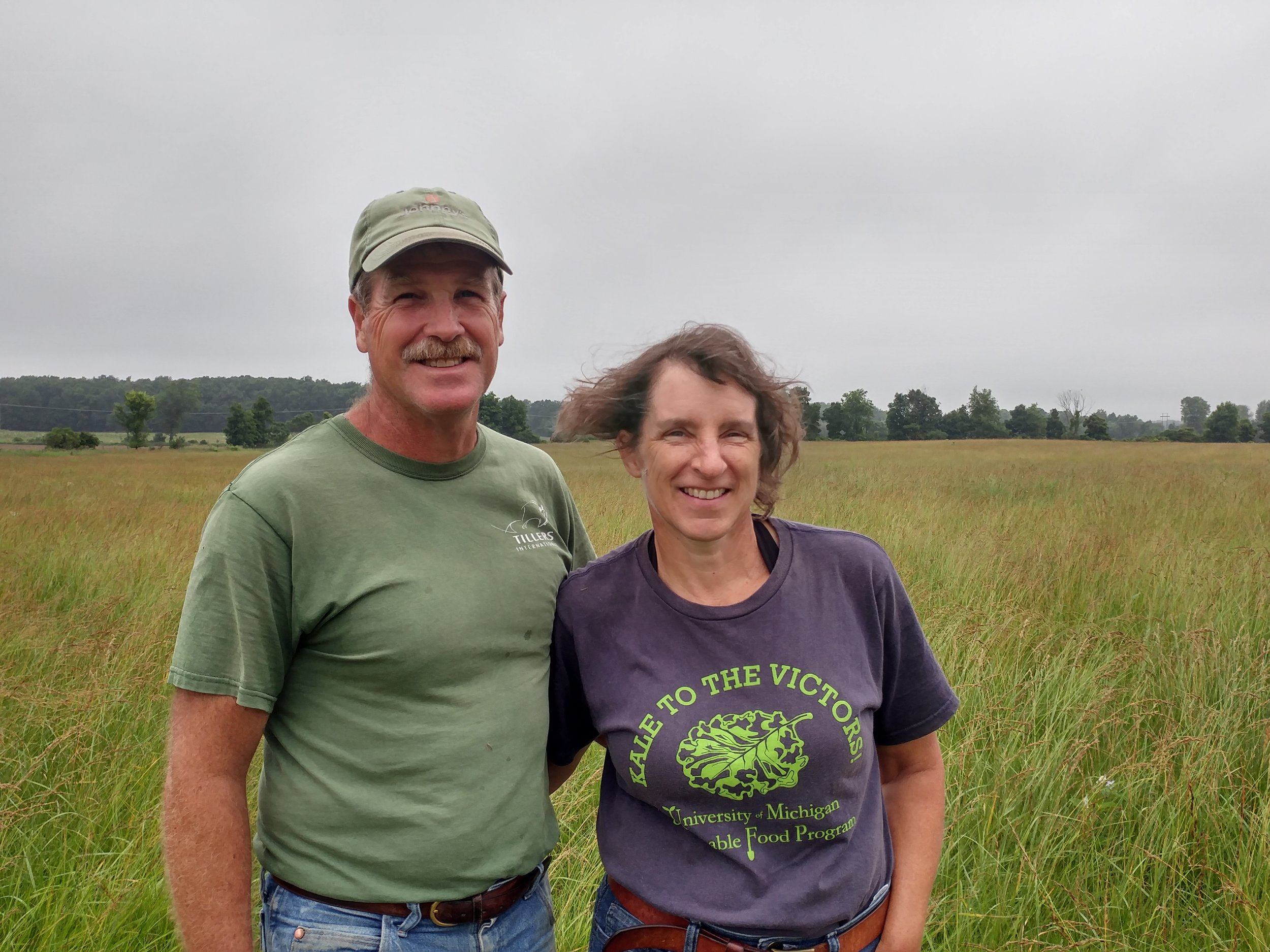 Pete and Lori in a portion of their grazing pasture. They are conscious of growing a variety of natural grazing grasses to mimic what would be available to sheep in the wild.