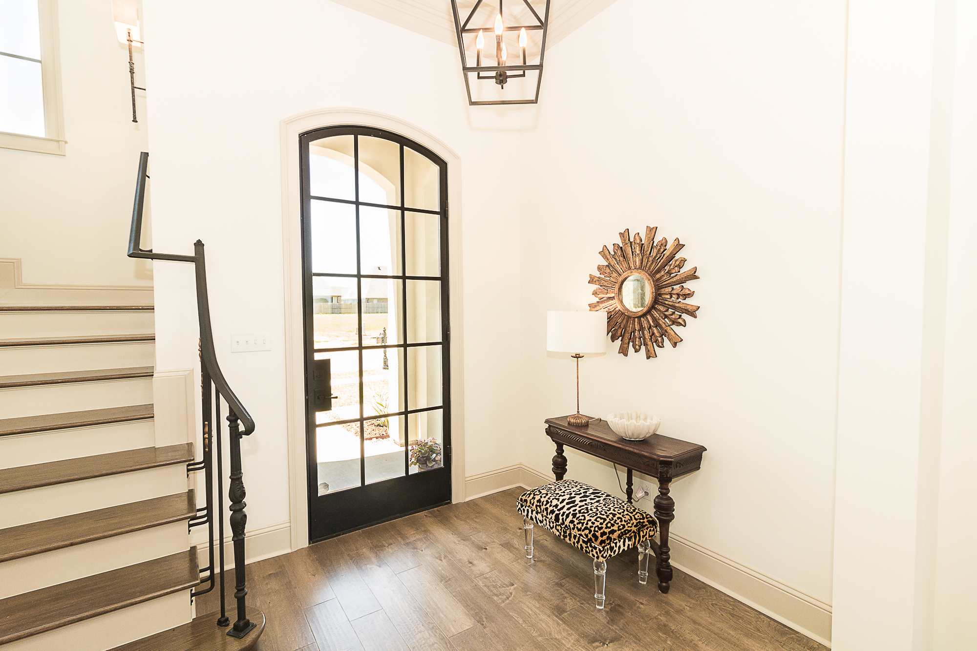 As we discussed in an earlier blog post, the front door captured everyone's attention upon entering.. the glass and steel, modern masterpiece made a great first impression!